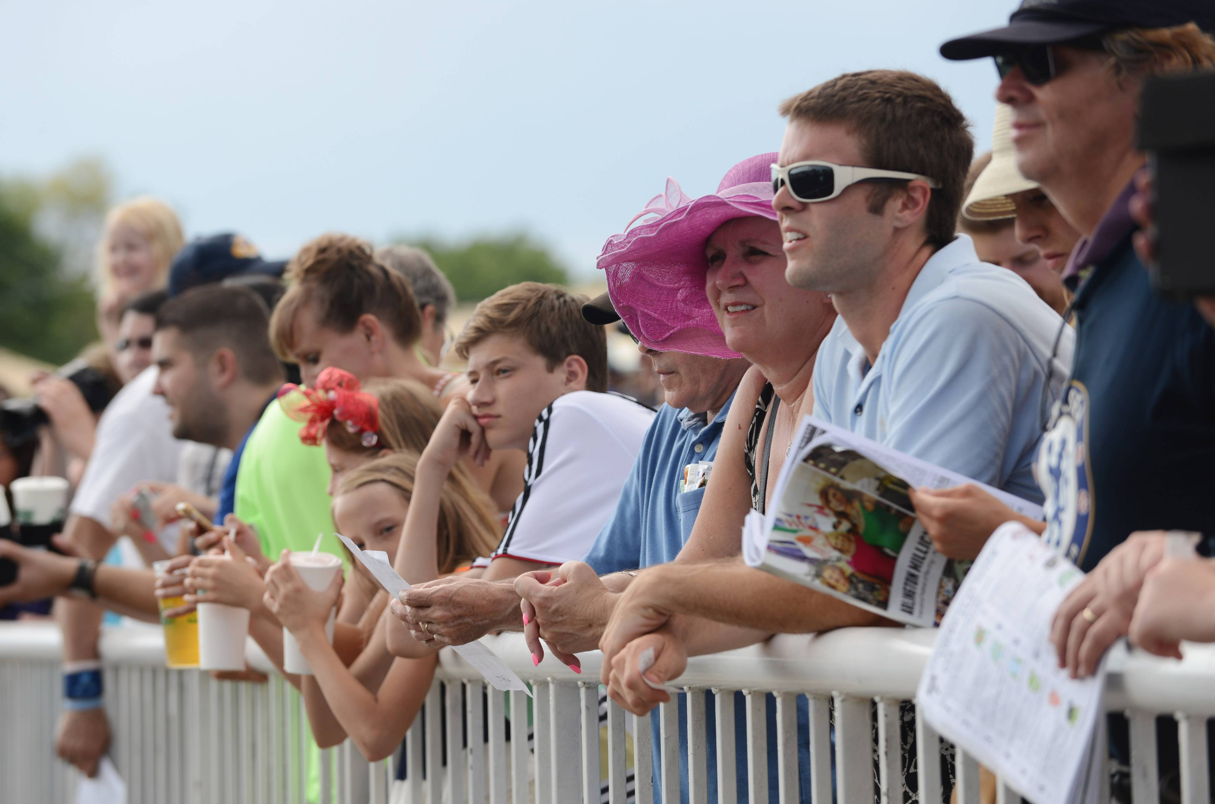 Fans line the rail Saturday during Arlington International Festival of Racing.