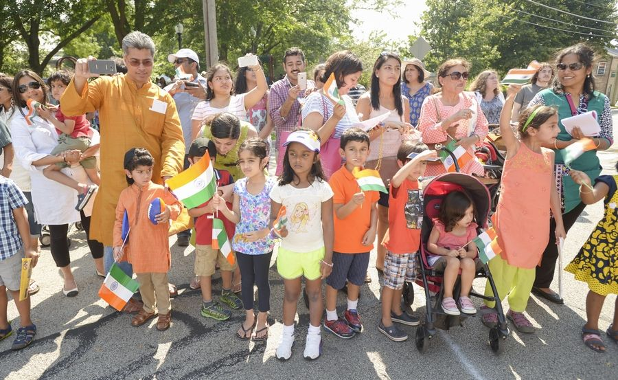 Spectators were waving American and Indian flags Sunday while watching the Naperville Indian Community Outreach's first India Day Parade. The event, and a ceremony that followed, celebrated India's 69th year of independence.