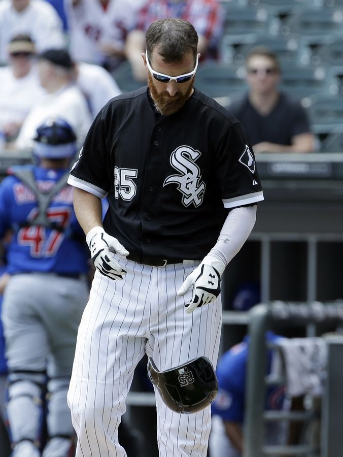 White Sox first baseman Adam LaRoche drops his helmet after striking out in the first inning of Sunday's game against the Cubs.