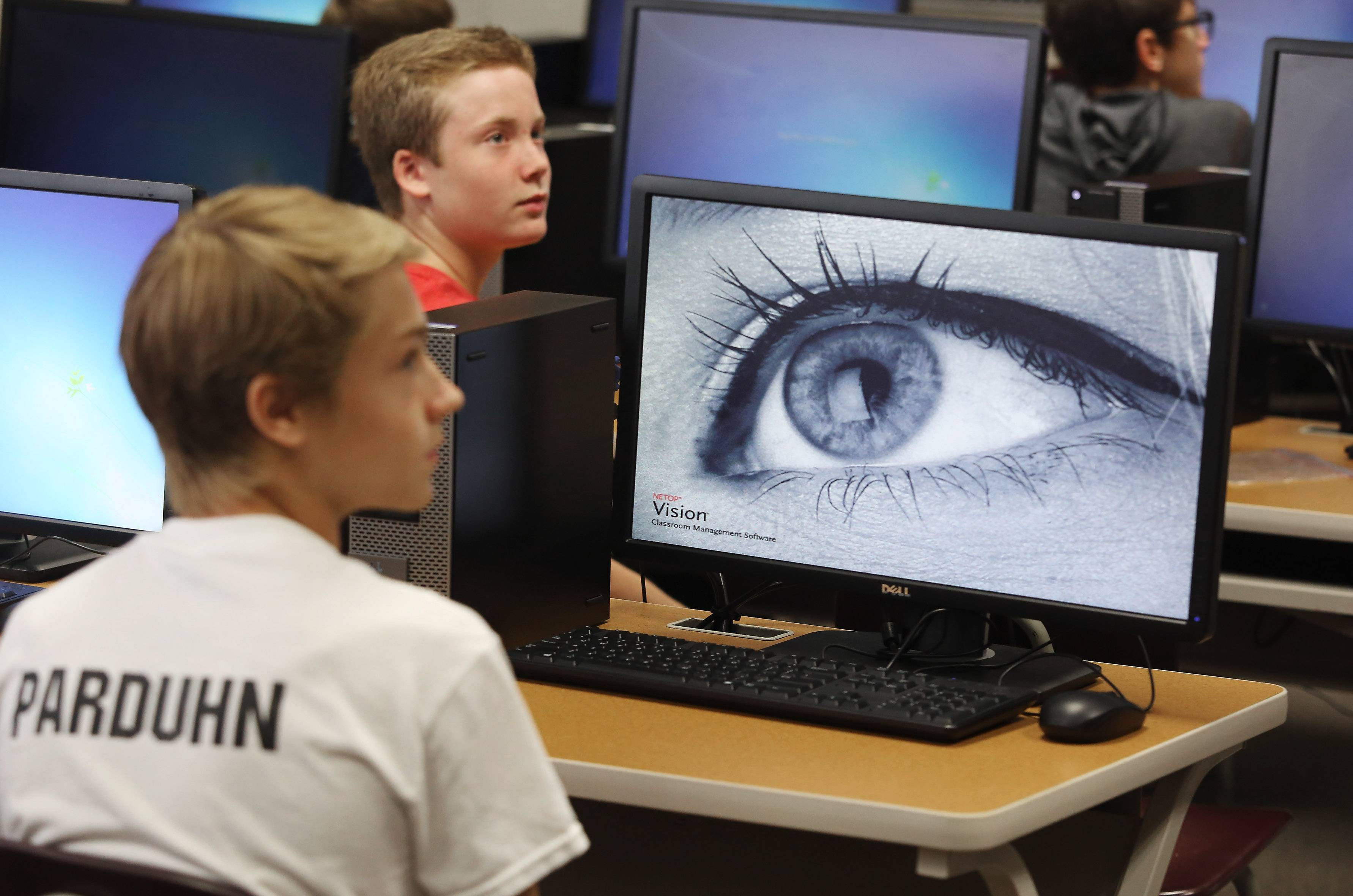 Freshman Michael Parduhn, left, listens to the teacher in computer applications class during the first day of school at Mundelein High School on Wednesday. The school is under construction and a new STEM wing is being built.