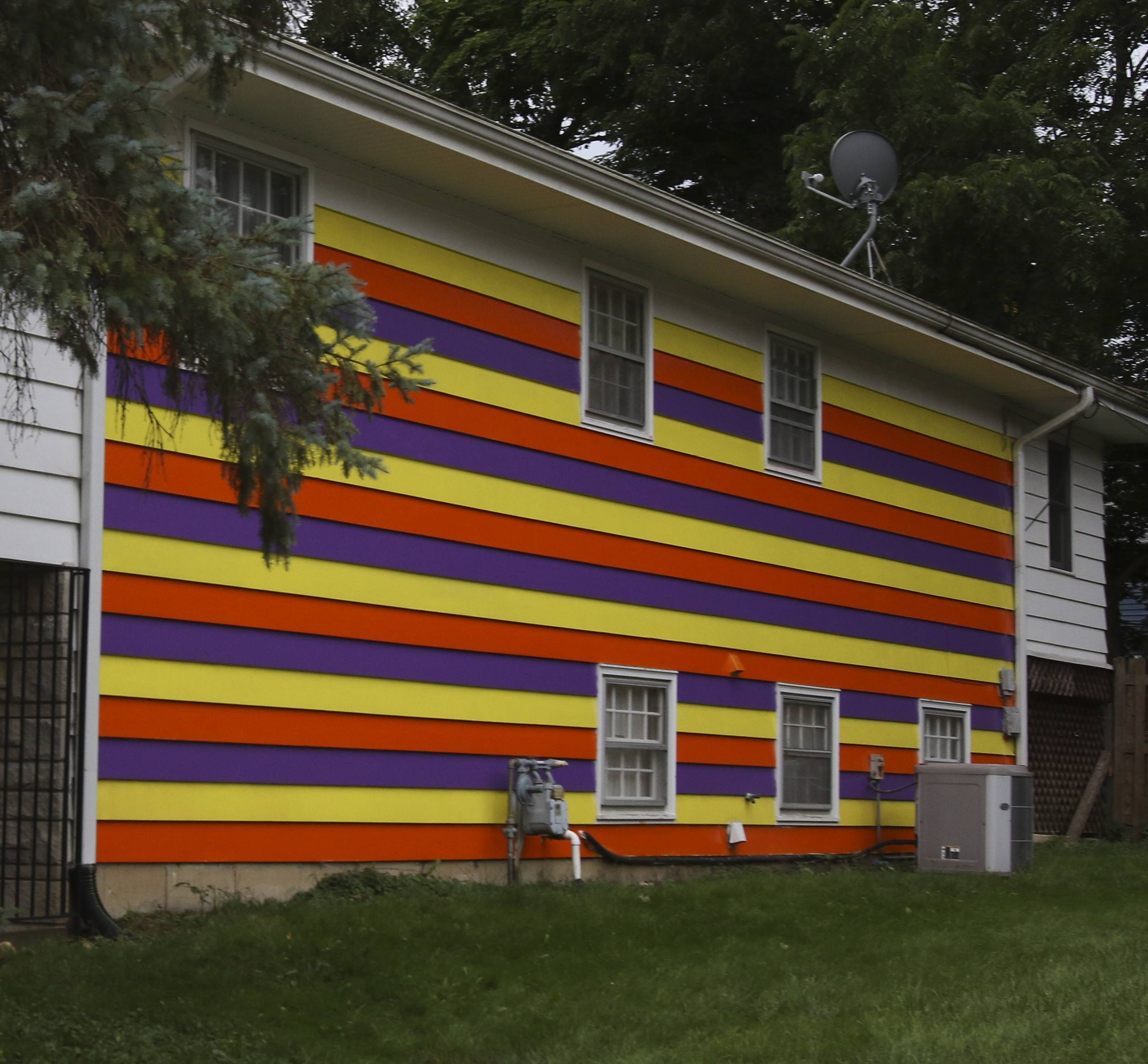 """It's kind of got to a boiling point,"" Denise Harrington said about a dispute in a Glen Ellyn neighborhood that prompted residents of this house to put up this colorful paint job."