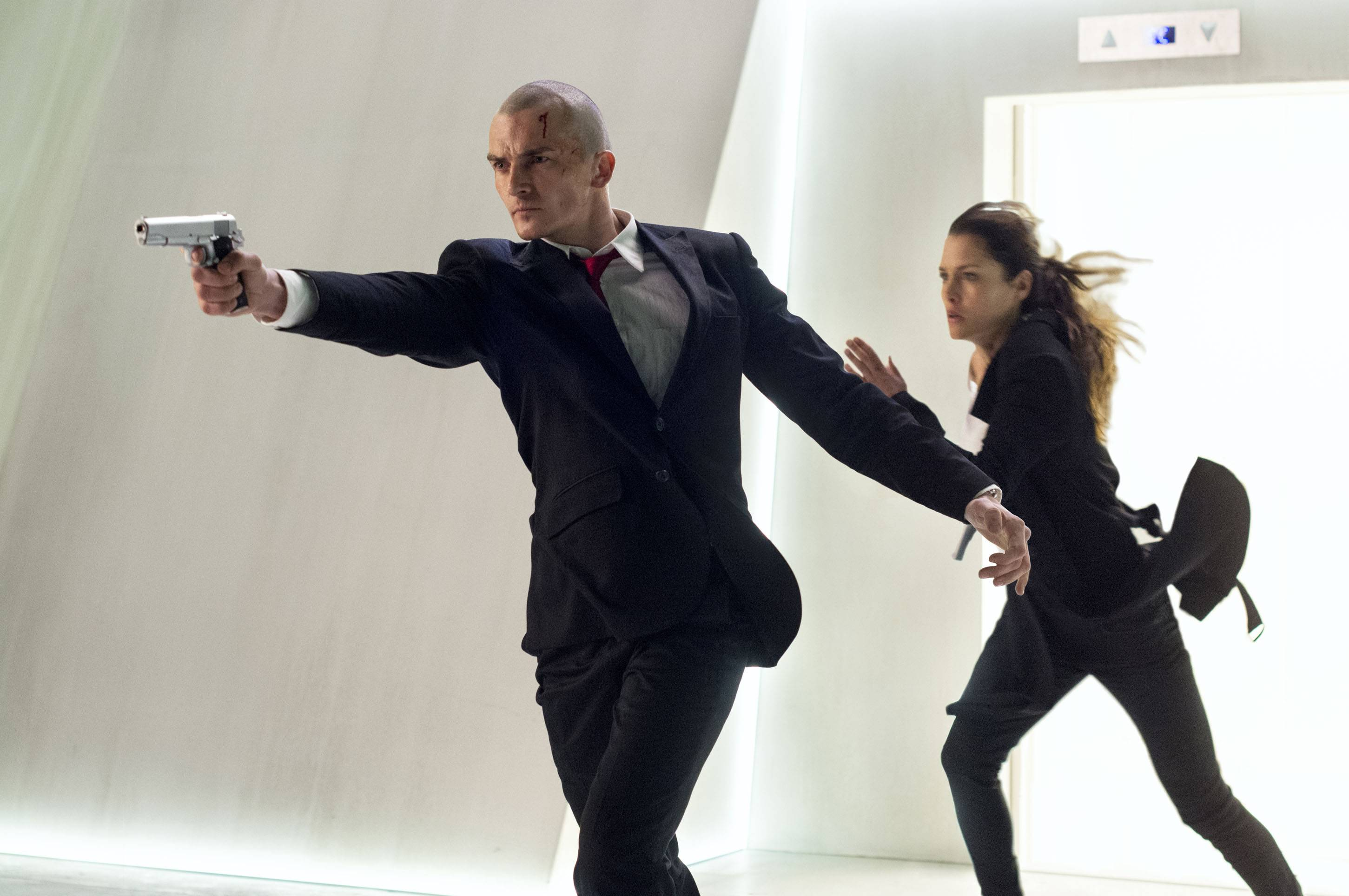 "Agent 47 (Rupert Friend) comes to the rescue of Katia (Hannah Ware) during one of too many action sequences from ""Hitman: Agent 47."""