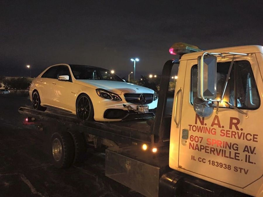 Naperville police said they recovered three luxury cars Wednesday night during a raid of a poker ring, including this one, a 2014 Mercedes E63 AMG.
