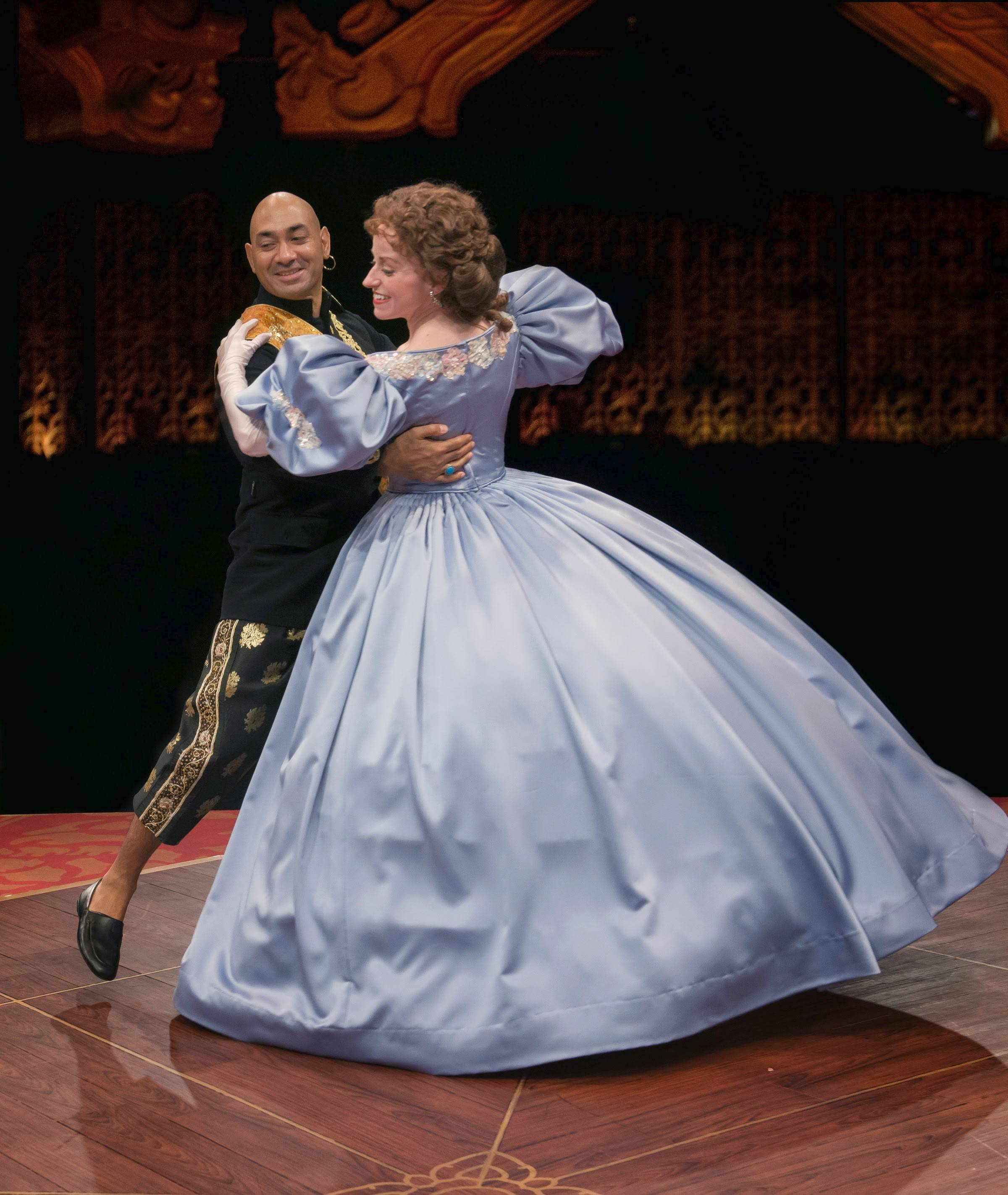 "Mrs. Anna Leonowens (Heidi Kettenring) teaches the King of Siam (Andrew Ramcharan Guilarte) how to polka in Marriott Theatre's revival of Rodgers and Hammerstein's ""The King and I."" The production received five of Marriott's 12 equity Jeff Award nominations."