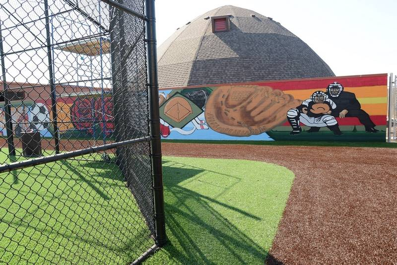Sports themed mural to be dedicated in rosemont for Baseball field mural