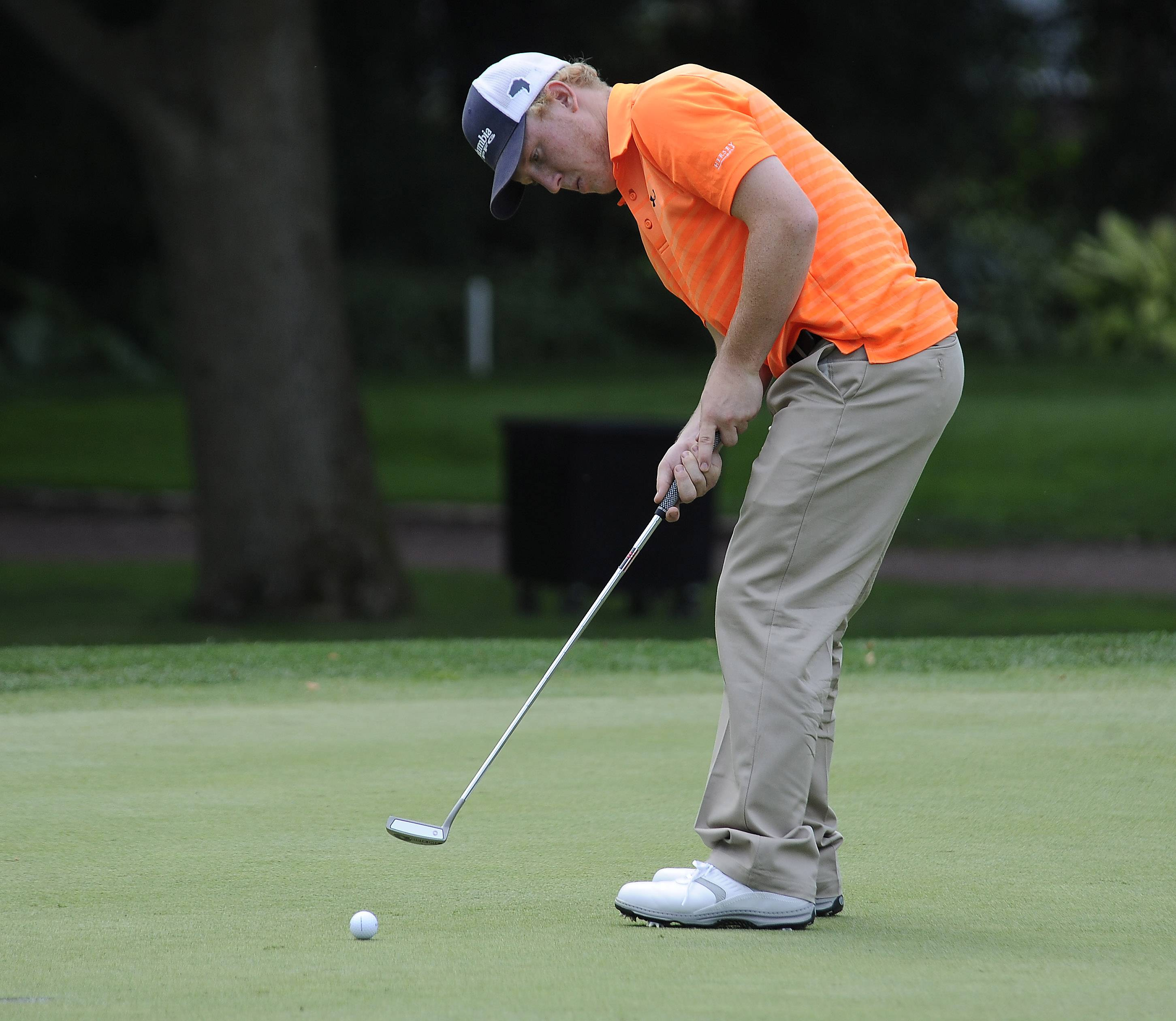Hersey senior Dan Wolf putts on hole No. 5 five at the Hersey Invitational golf contest at Rolling Green Country club in Arlington Heights on Monday.