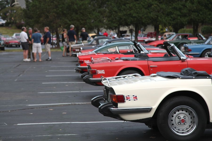 Participants gather around their vehicles at the 2015 Vintage Triumph Register National Convention in Fontana, Wisconsin.