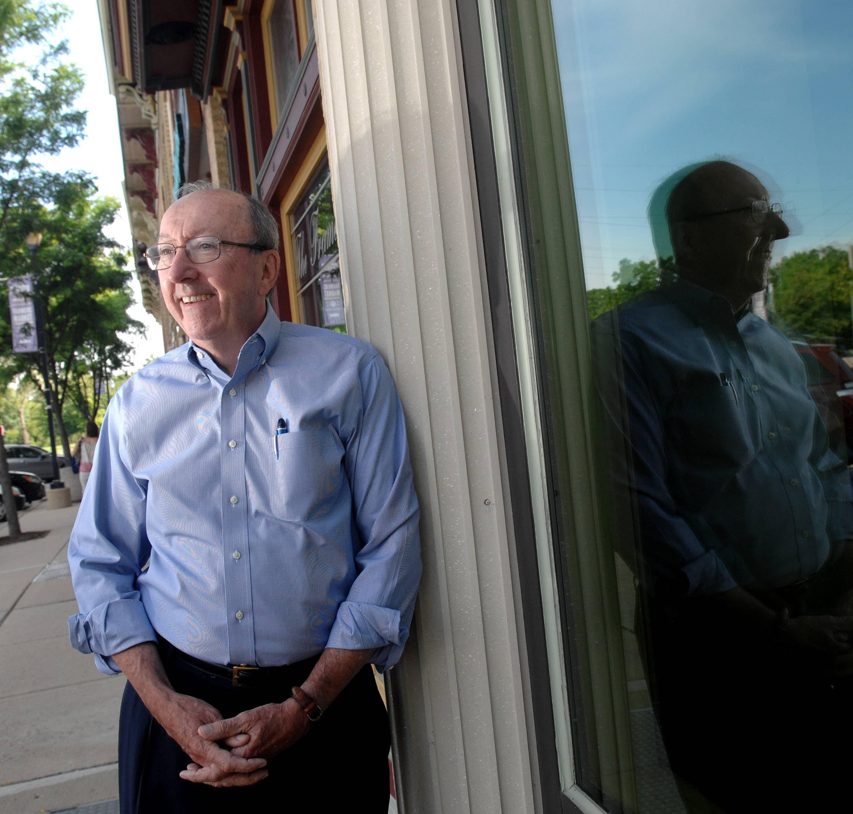 Tom Roeser, president of Otto Engineering, stands along River Street in East Dundee, where he has purchased and renovated six buildings used mostly for retail space.