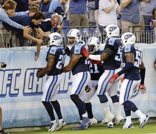 Tennessee Titans defensive back Perrish Cox (29) celebrates with teammates and fans after intercepting a pass against the St. Louis Rams and running it back for a touchdown during the first half of a preseason NFL football game Sunday, Aug. 23, 2015, in Nashville, Tenn. (AP Photo/James Kenney)