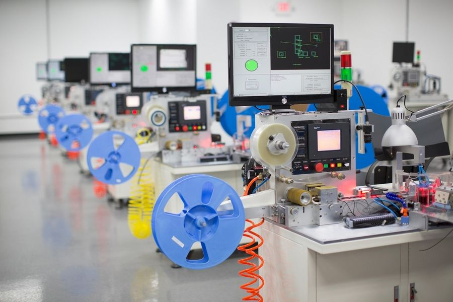 This equipment in Bi-Link's Bloomingdale headquarters inspects, packs and records data automatically for metal parts used in high-volume wireless applications. Bi-Link has manufacturing operations in China.
