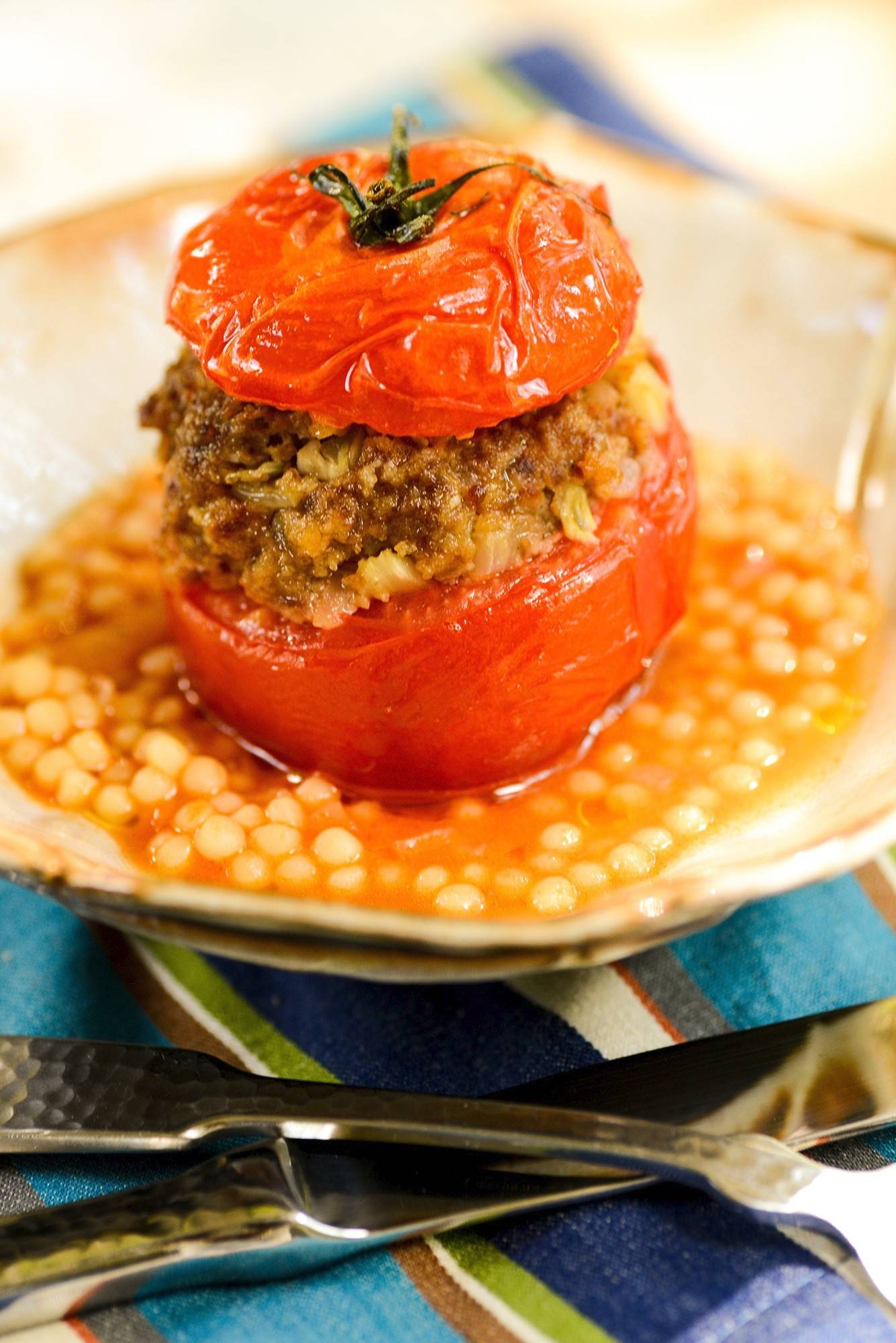 This stuffed tomato recipe uses a middling-quality tomato as a vessel for baking savory little meatloaves.