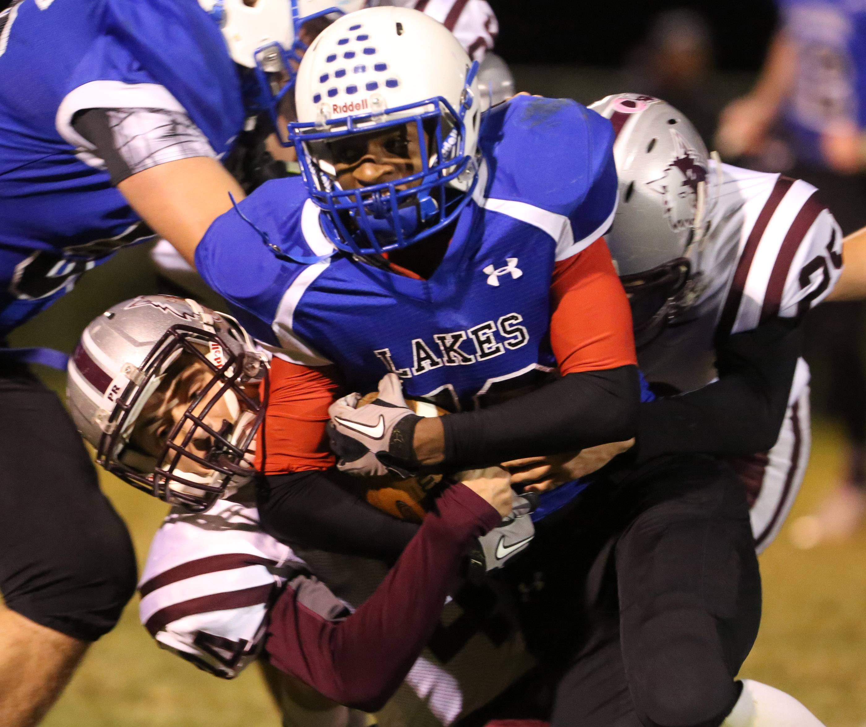 Lakes running back Izayah James is pulled down by Prairie Ridge defender Nicholas Greenberg last season. Greenberg returns this season for the defending Fox Valley Conference Fox Division champions.