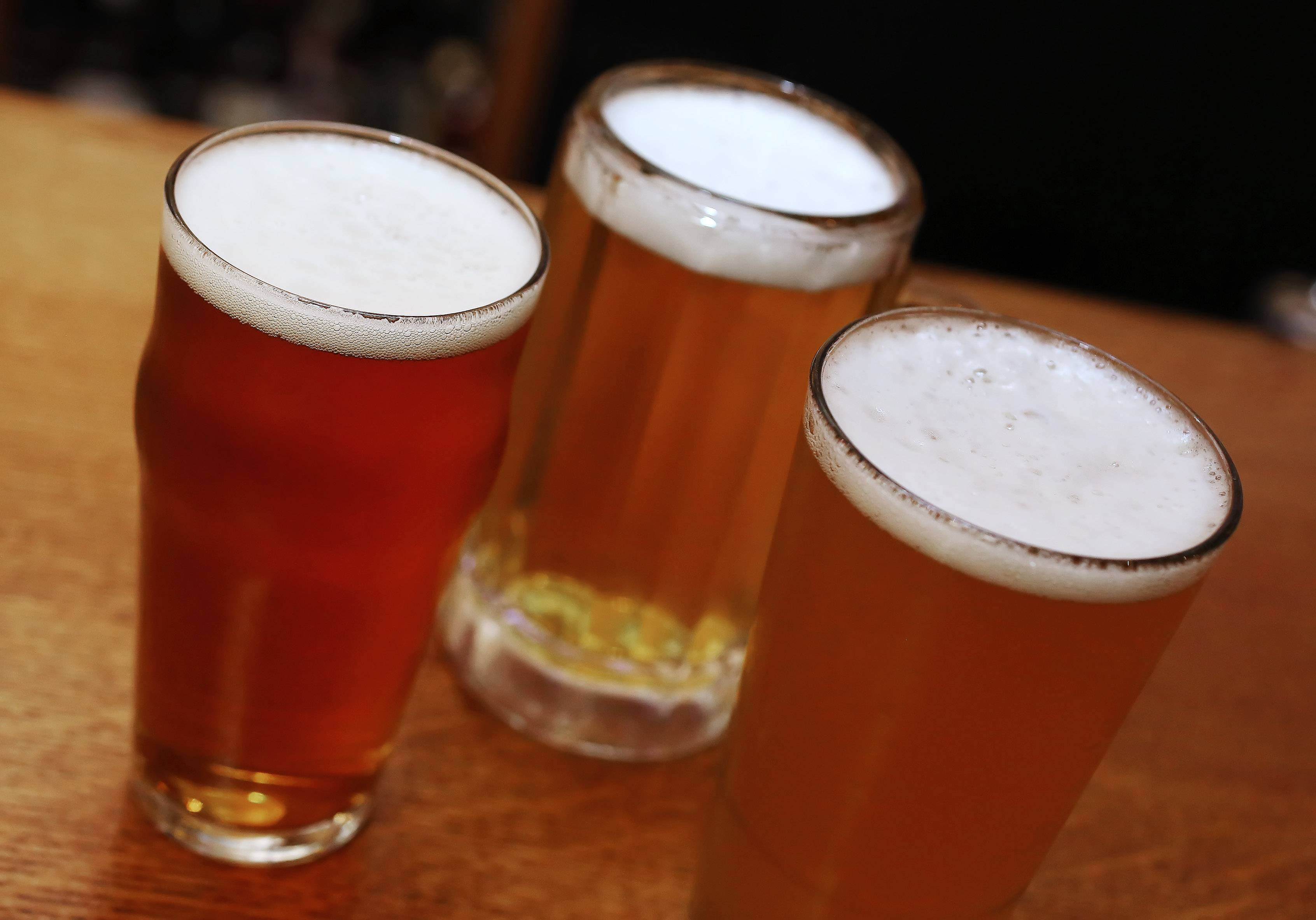 "Mickey Finn's beers include ""Sesh"" Session Ale, left, Helles Bells and 847 Suburban Wheat Ale."