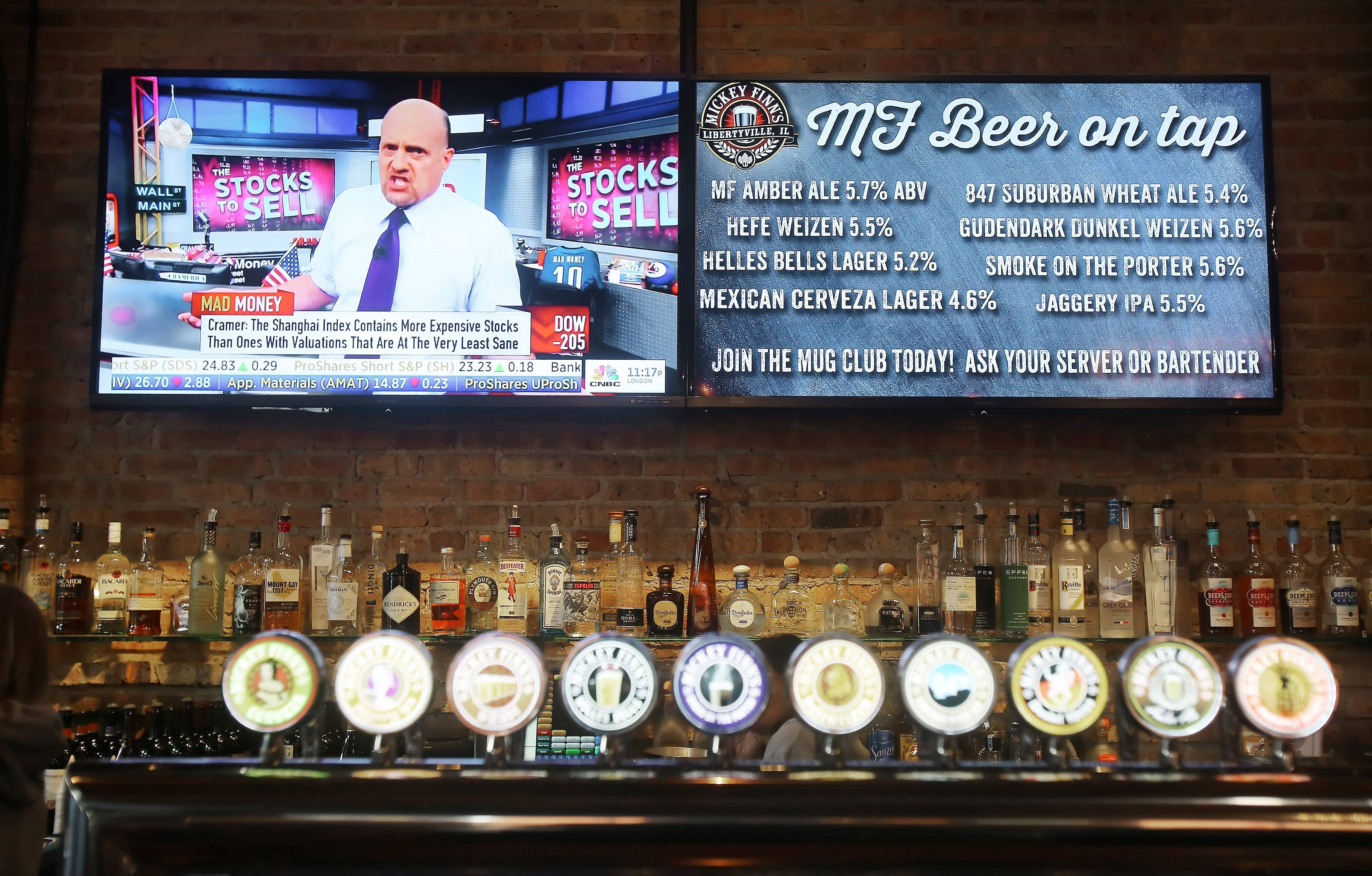 A screen lists the beer menu at Mickey Finn's in Libertyville.