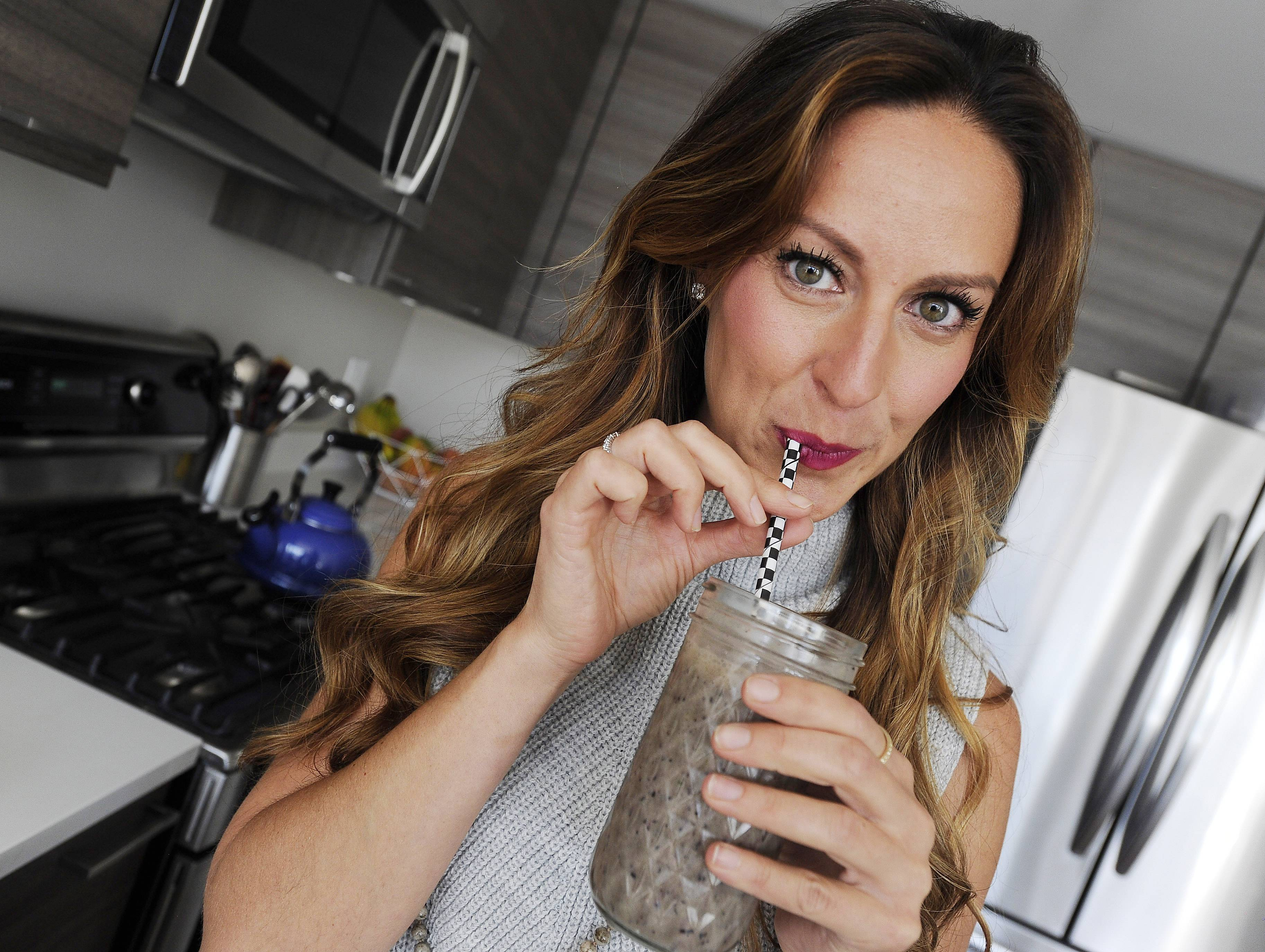 Mount Prospect native Kendra Peterson is the founder of Drizzle Kitchen, a private chef service company. She samples one of her smoothies, a drink she makes for her clients.