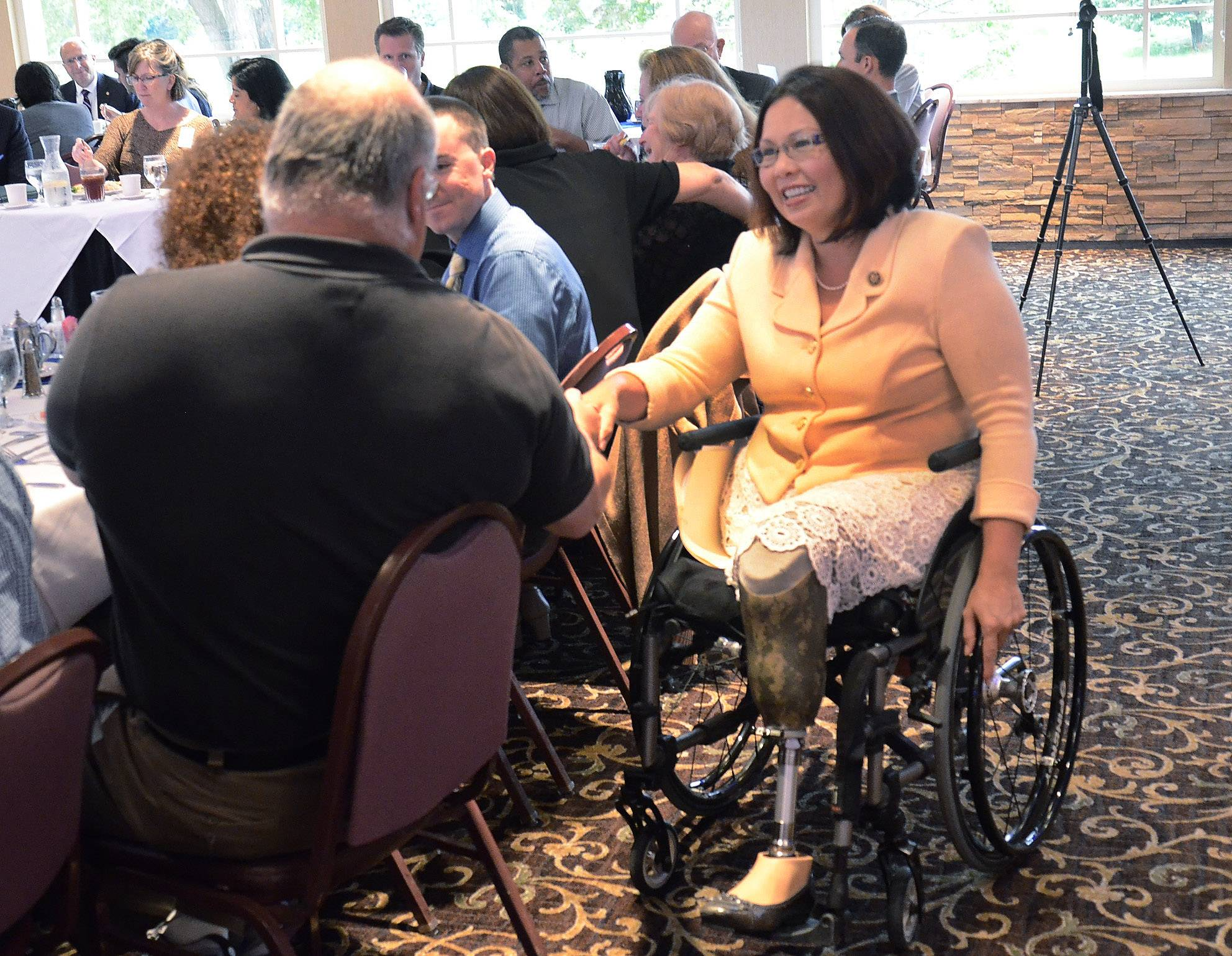 U.S. Rep. Tammy Duckworth visits with members before speaking at the Schaumburg Business Association's Legislative Affairs luncheon.