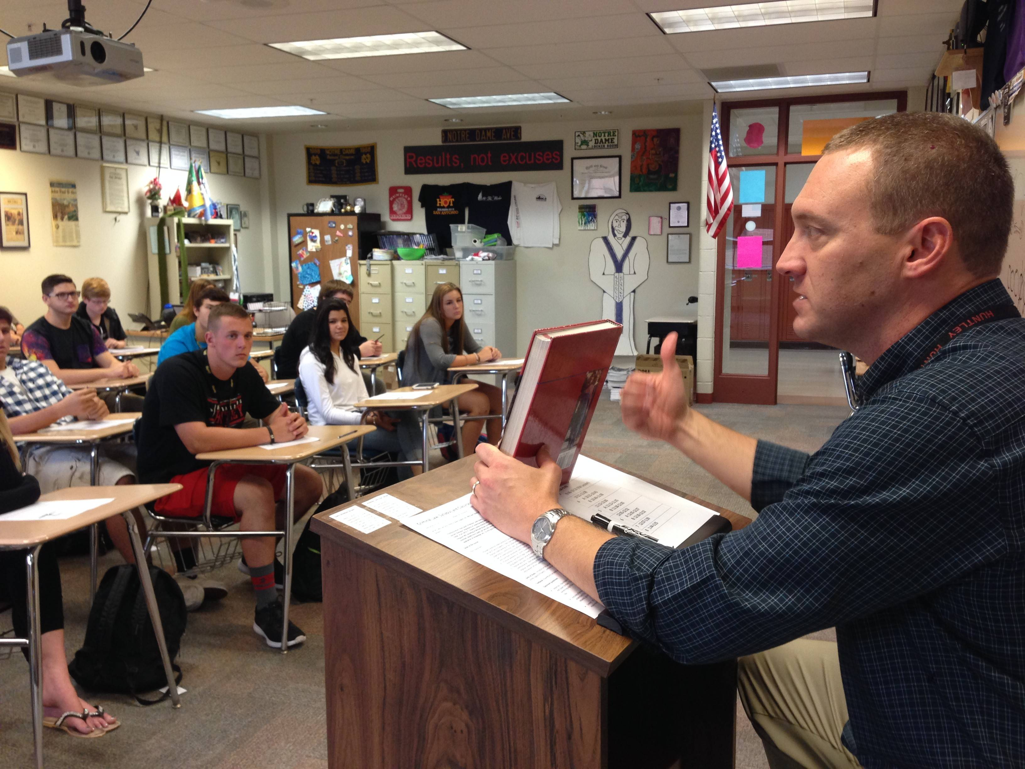 Huntley High School teacher Dennis Brown teaches criminal law to juniors and seniors during Wednesday's first day of classes. Roughly 650 teachers returned to classrooms as the teachers union and Huntley Community School District 158 school board were in mediation over a new contract.
