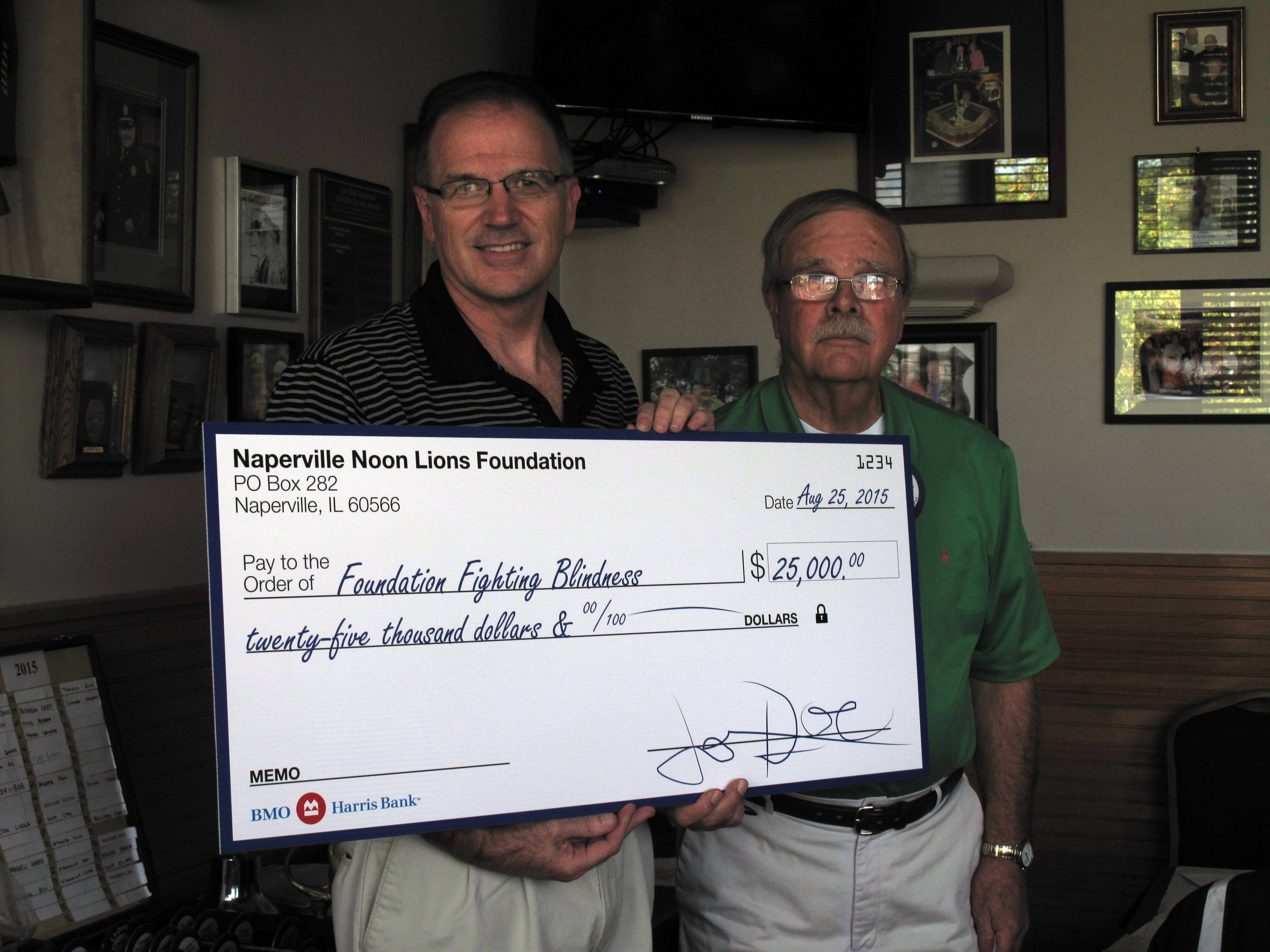John Cornielle of DeKalb, left, a volunteer with the Foundation Fighting Blindness, receives one of the largest donations the Naperville Noon Lions Club ever has given. At right is Bob Hull, president of the club, which gave $25,000 to support research for a cure to blindness caused by inherited retinal diseases.