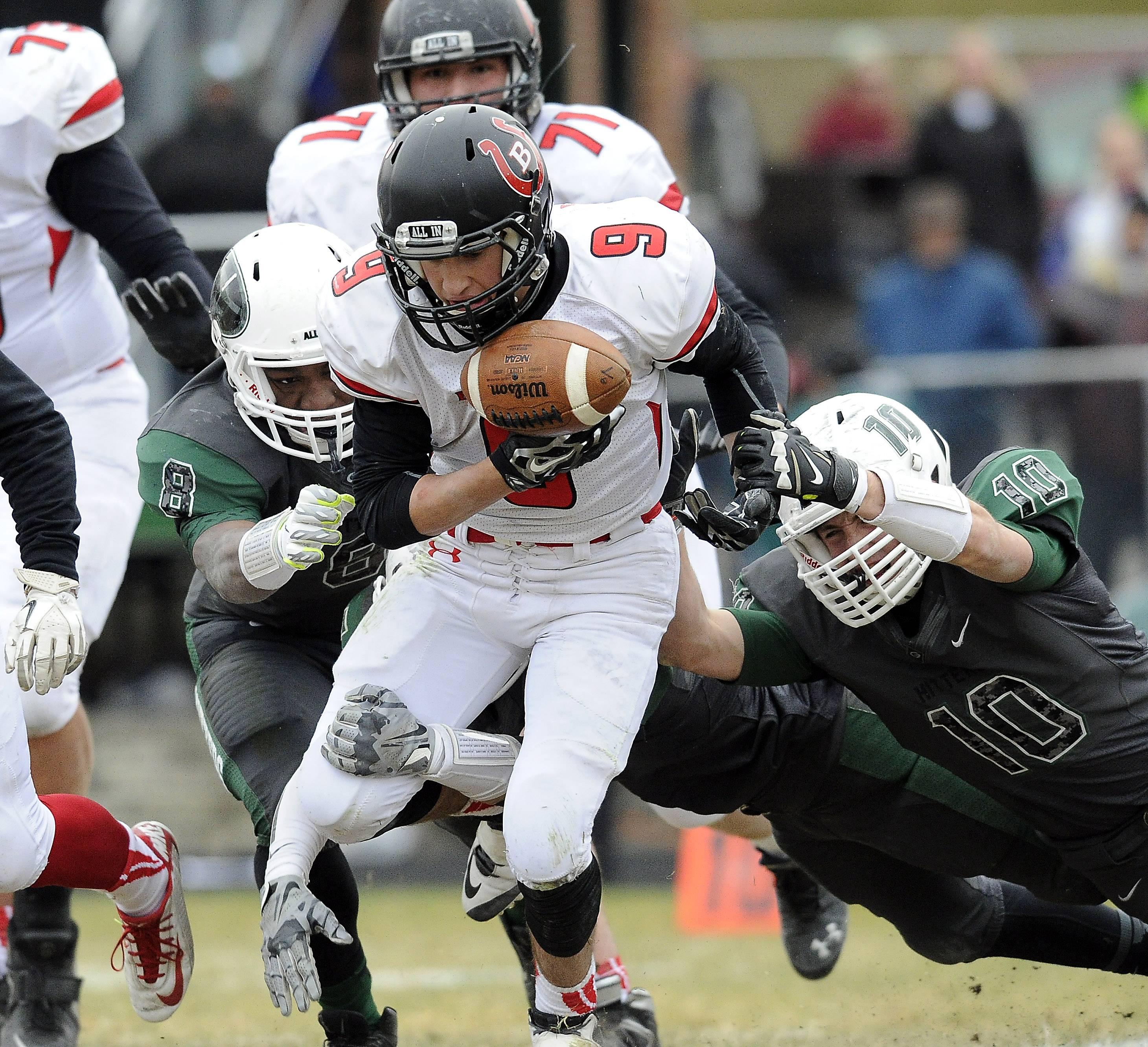 Barrington quarterback Johnny Davidson takes pressure from Glenbard West's defense during Class 8A playoff action last fall in Glen Ellyn.