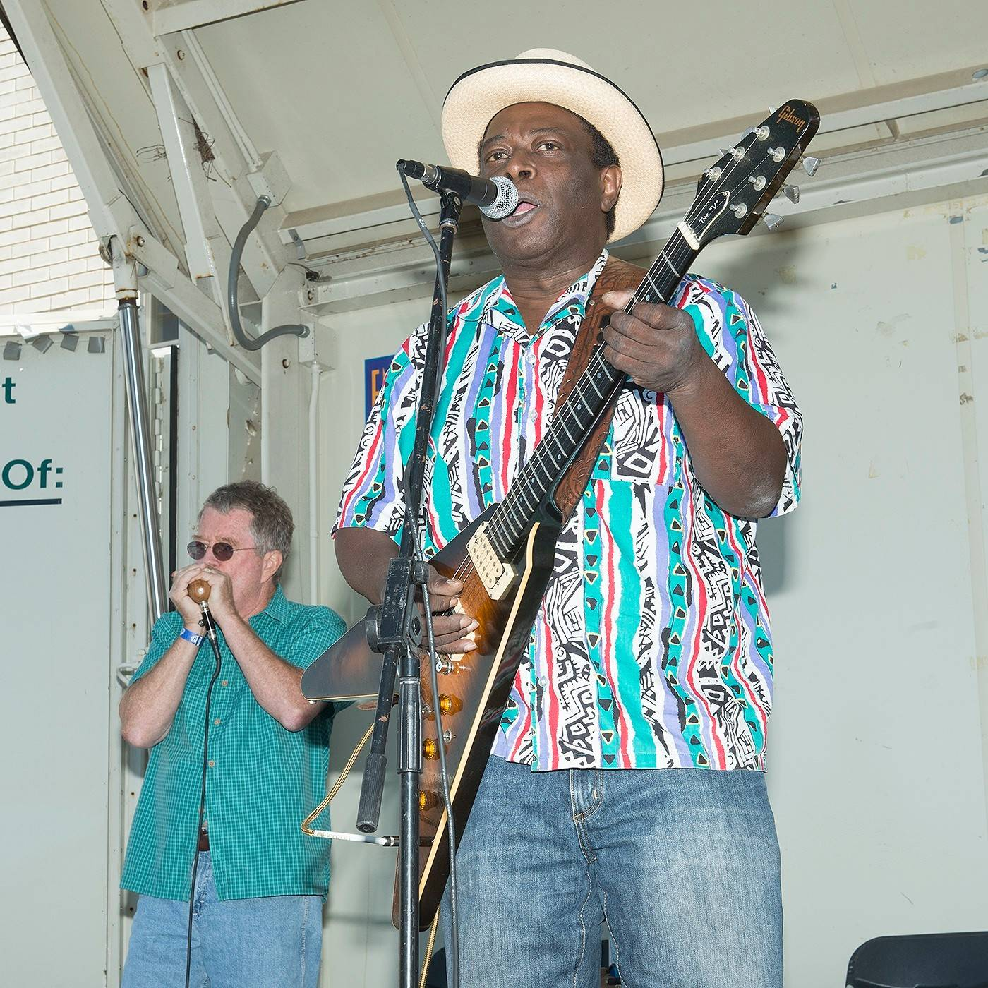 Blues guitarist Chainsaw Dupont on his Gibson Flying V played a previous Glen Ellyn Ellyn Backyard BBQ concert.