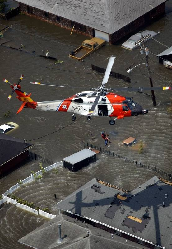 a resident is rescued from the roof top of a home by the us coast guard