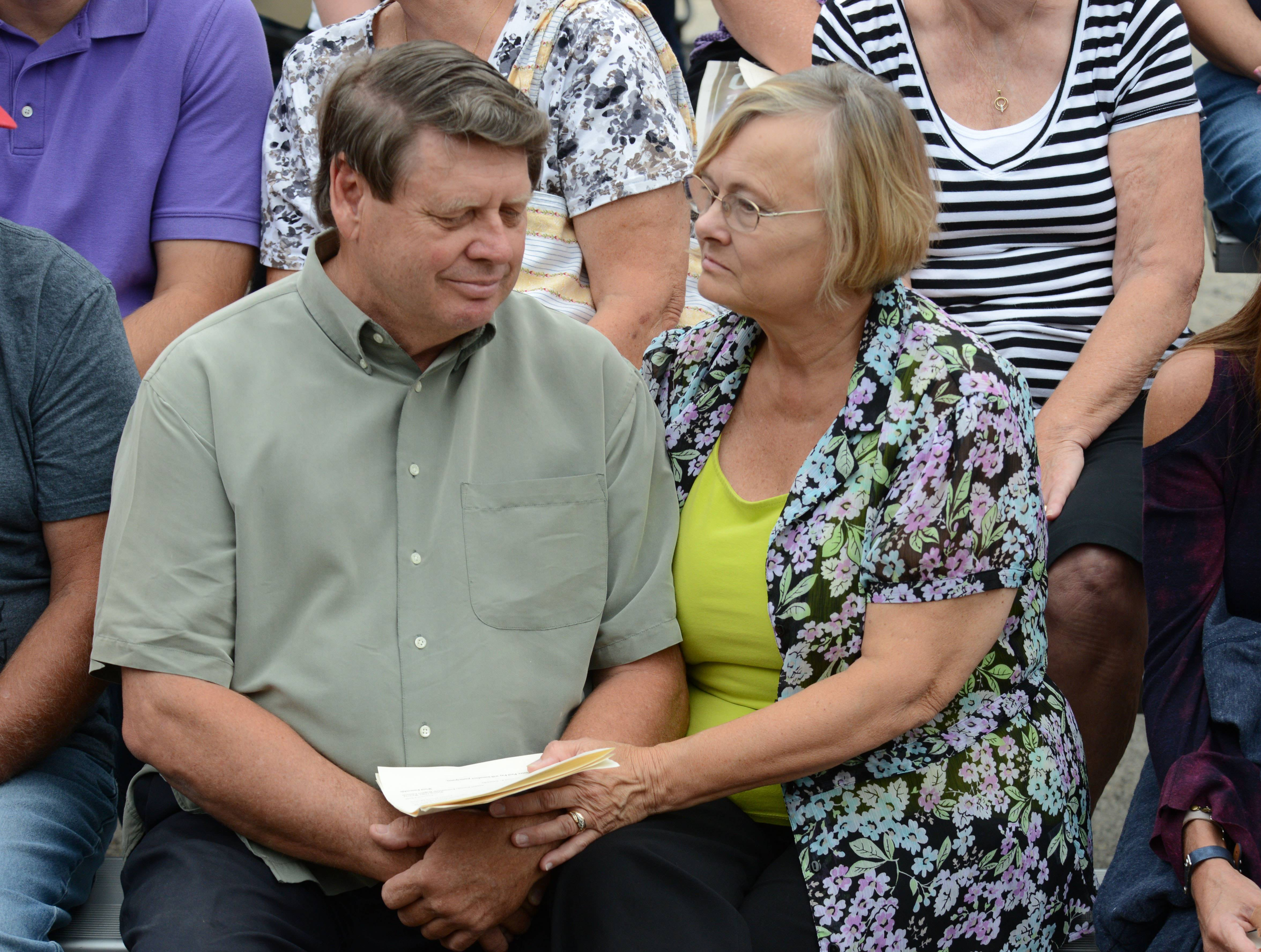 Judith Kachel comforts her husband Larry during a memorial for the 25th anniversary of the Plainfield-area tornado that killed 29 people, including Larry's brother, James.