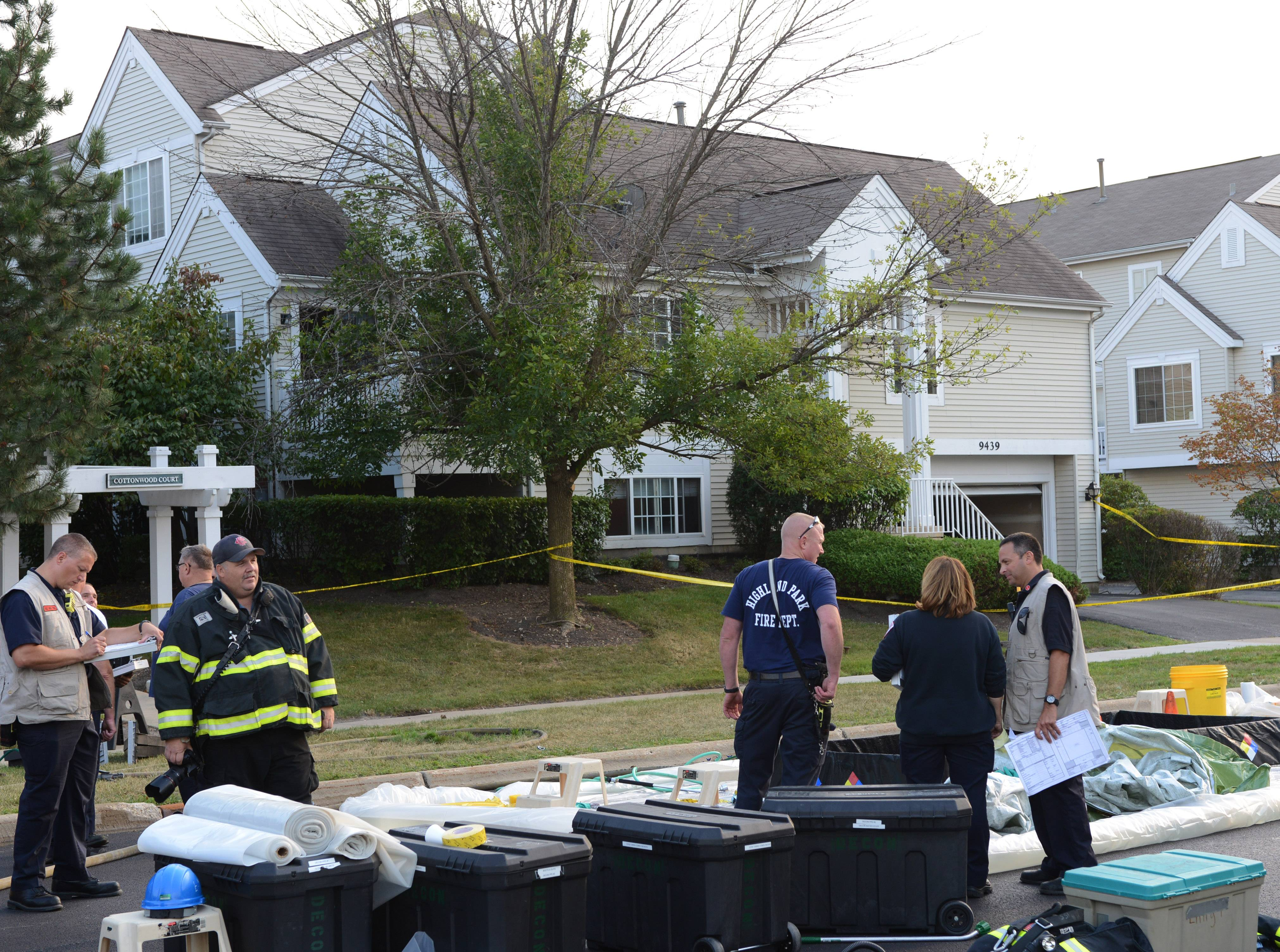 Emergency responders in front of the home on Harrison Street Thursday afternoon.