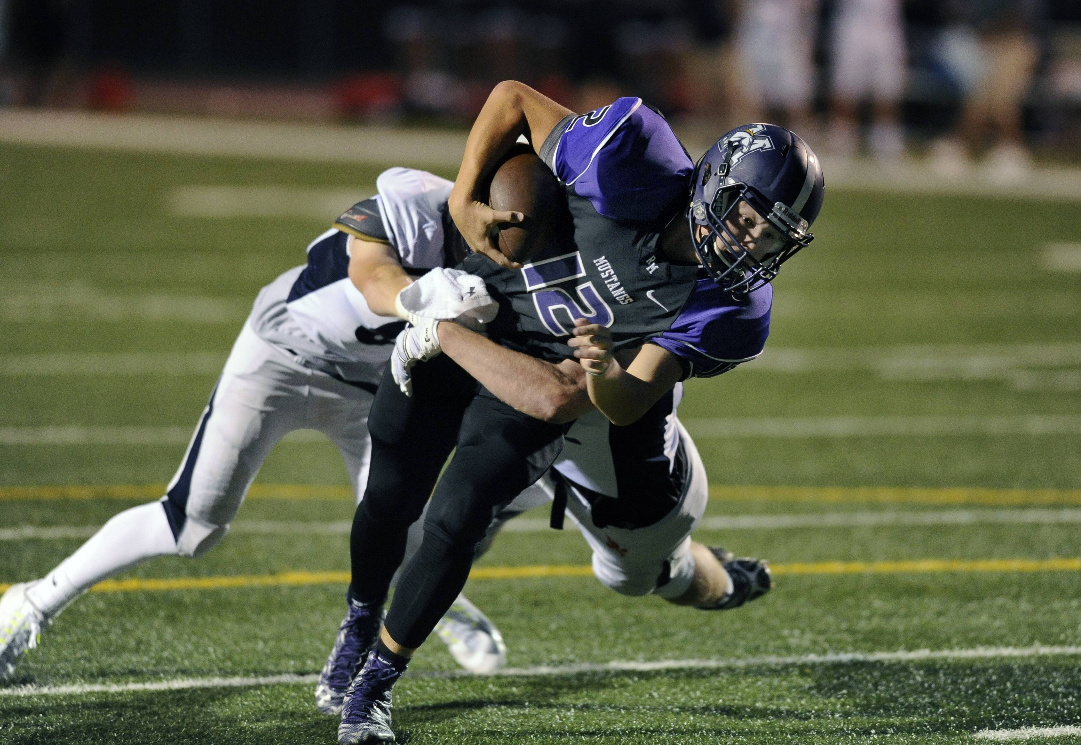 Quarterback Asher O'Hara finds the end zone with the first touchdown of the season for Rolling Meadows on Friday night against visiting St. Viator.