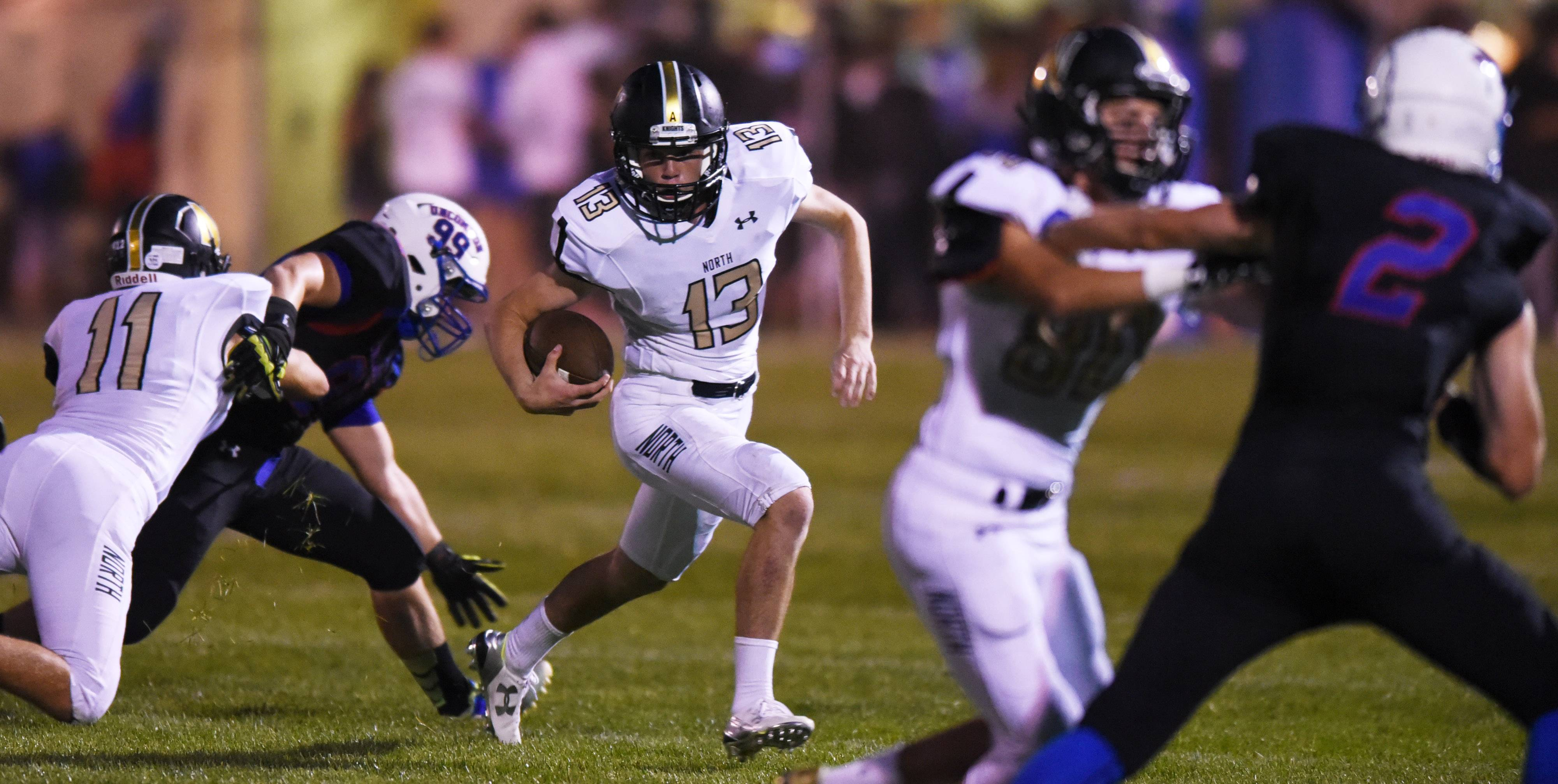 Grayslake North quarterback Jacob Wright carries the ball against Lakes during Friday's season opener in Lake Villa.