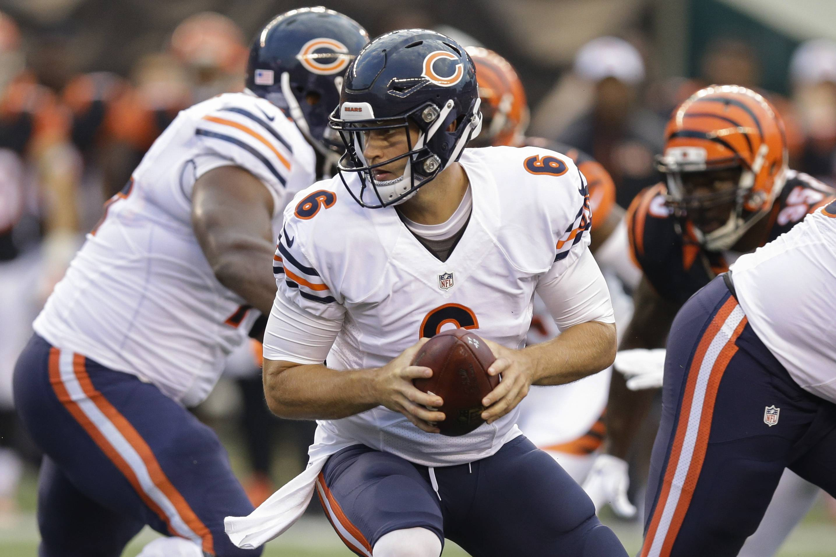 Chicago Bears quarterback Jay Cutler looks to hand off the ball during the first half of an NFL preseason football game against the Cincinnati Bengals, Saturday, Aug. 29, 2015, in Cincinnati.