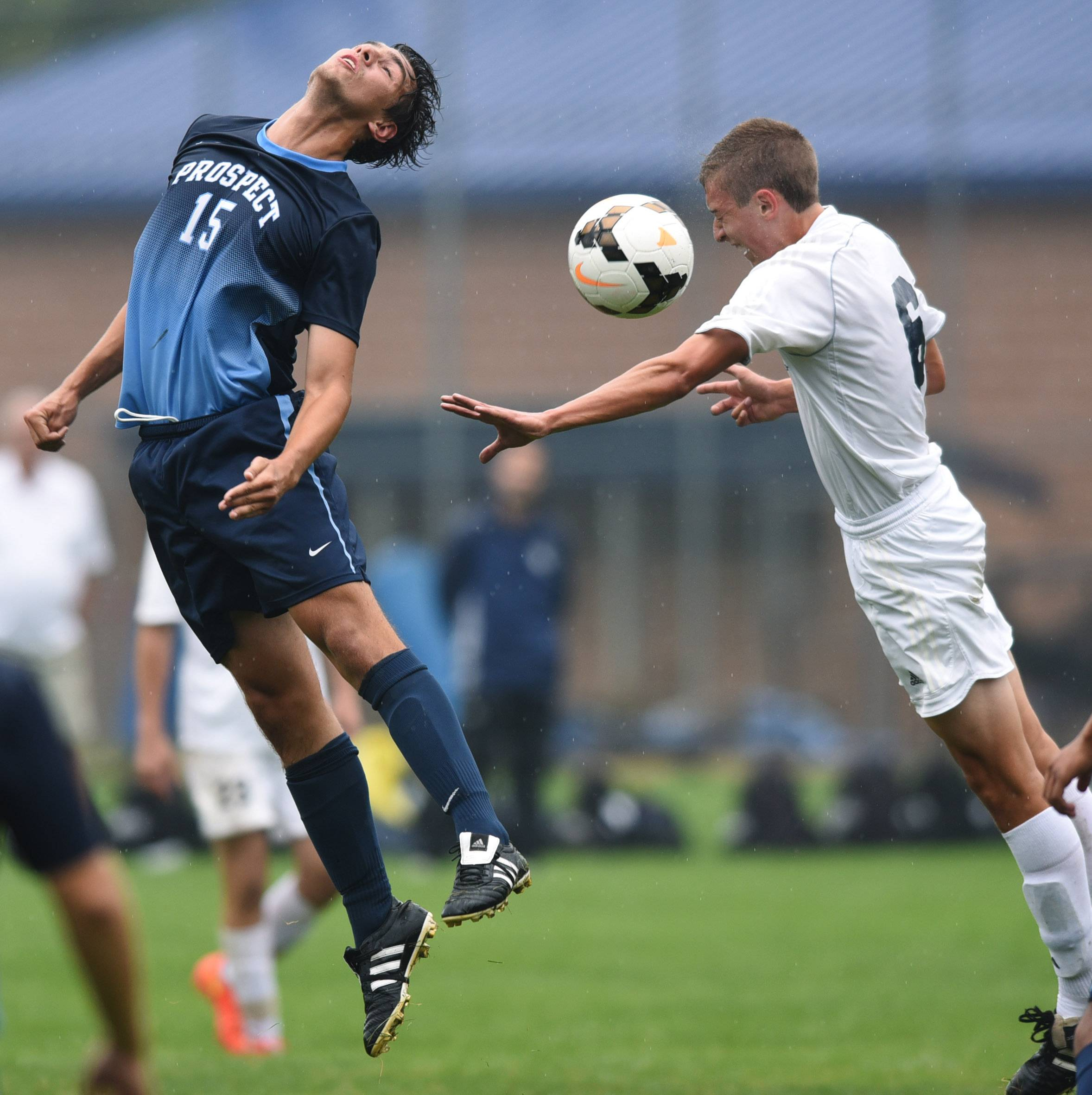 Prospect's Eryk Soltys, left, and St. Viator's Miles McDonnell try to direct the ball with a header during Saturday's game in Arlington Heights.