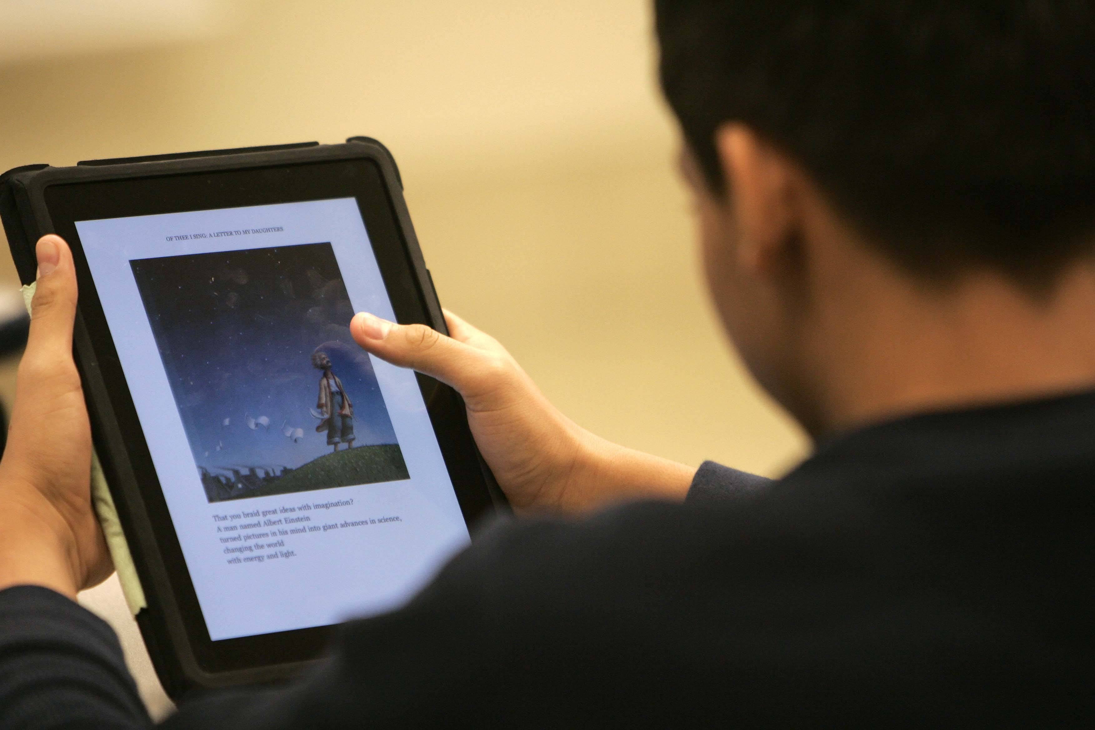 Students at the Newcomer Center in Arlington Heights work with iPads. Northwest Suburban High School District 214 aims to put iPads in the hands of its more than 12,000 students.