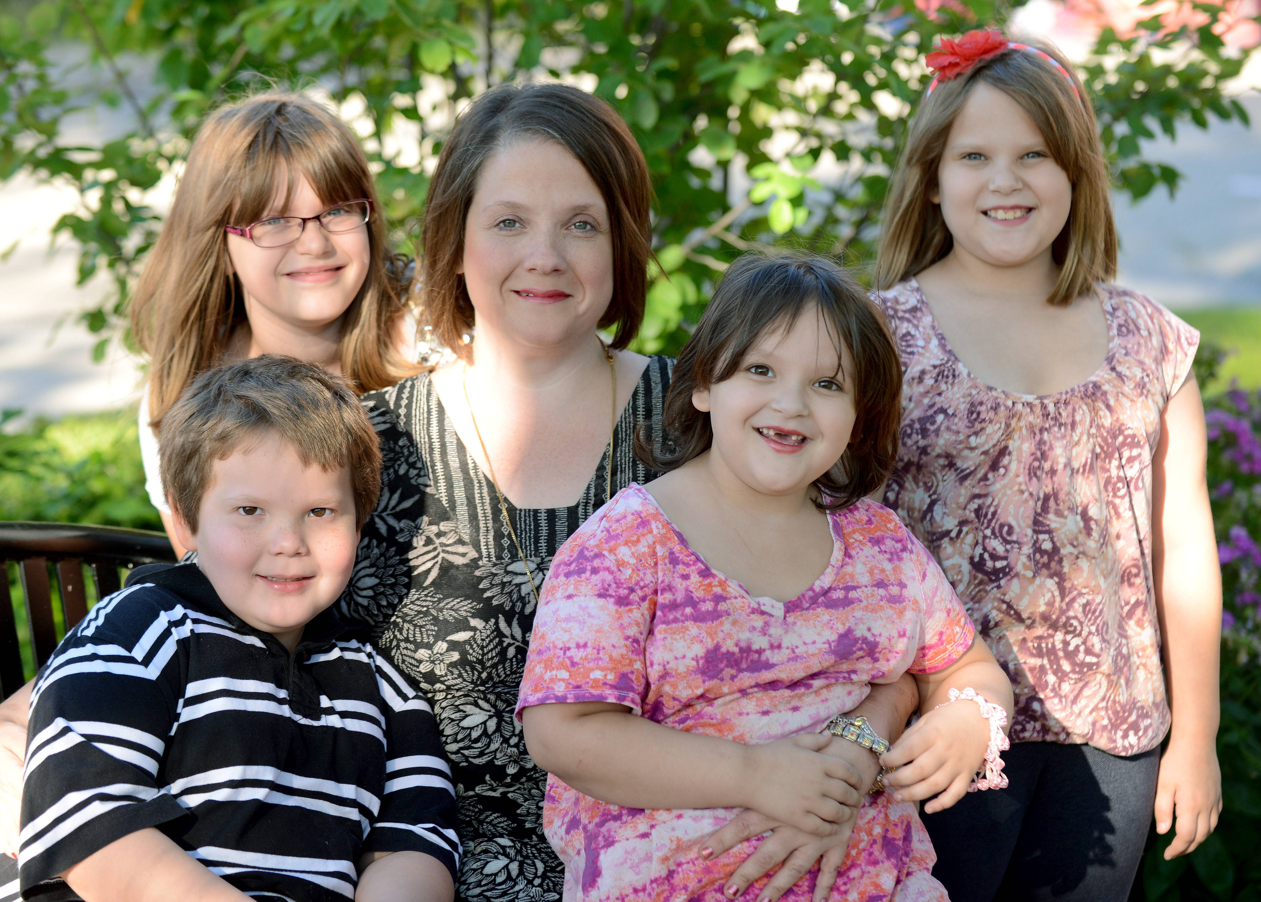 Stacey Schnaitman of Geneva is seeking financial help via GoFundMe to get a divorce from her husband, who is awaiting trial on domestic abuse charges in the Kane County jail. She is shown with her children, front row, left to right: JJ, 7; Aslyn, 5. Back row, left to right: Greer, 10; Cheyenne, 9.