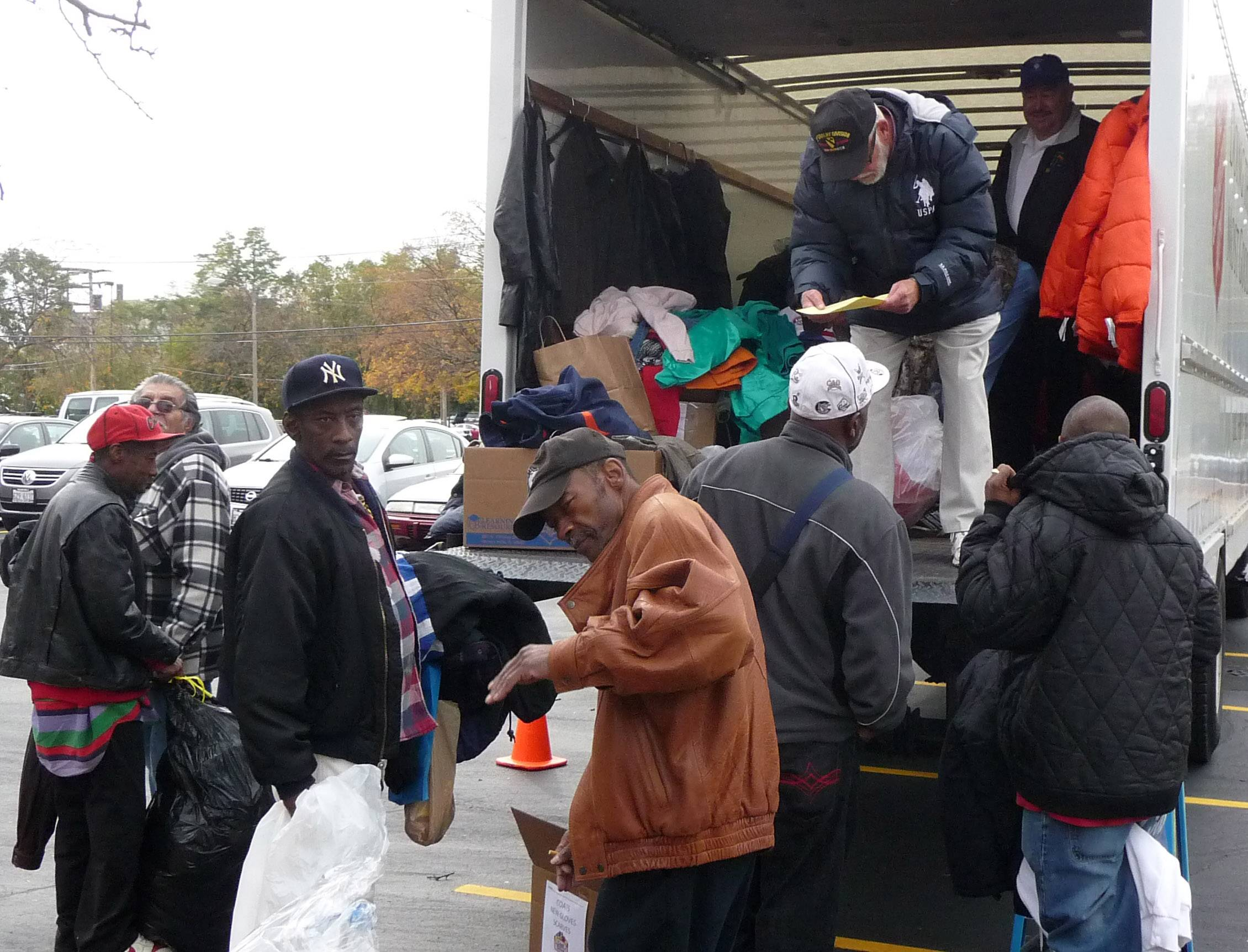 Veterans receive winter coats as part of the Stand Down organized by the Veterans's Assistance Commission of Lake County. High school football fans this year again are being asked to contribute.