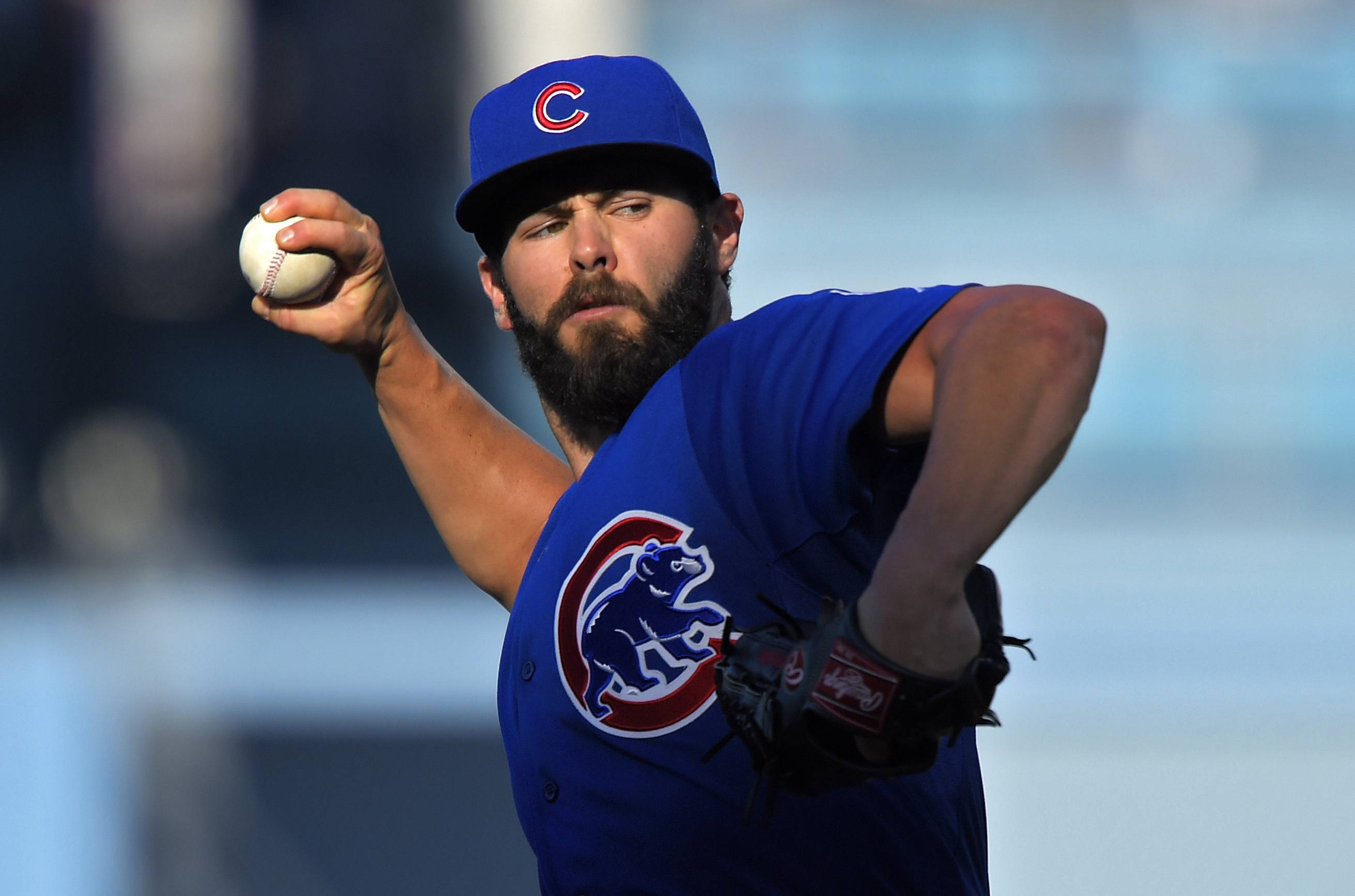 Chicago Cubs starting pitcher Jake Arrieta throws to the plate during the first inning of a baseball game against the Los Angeles Dodgers, Sunday, Aug. 30, 2015, in Los Angeles.