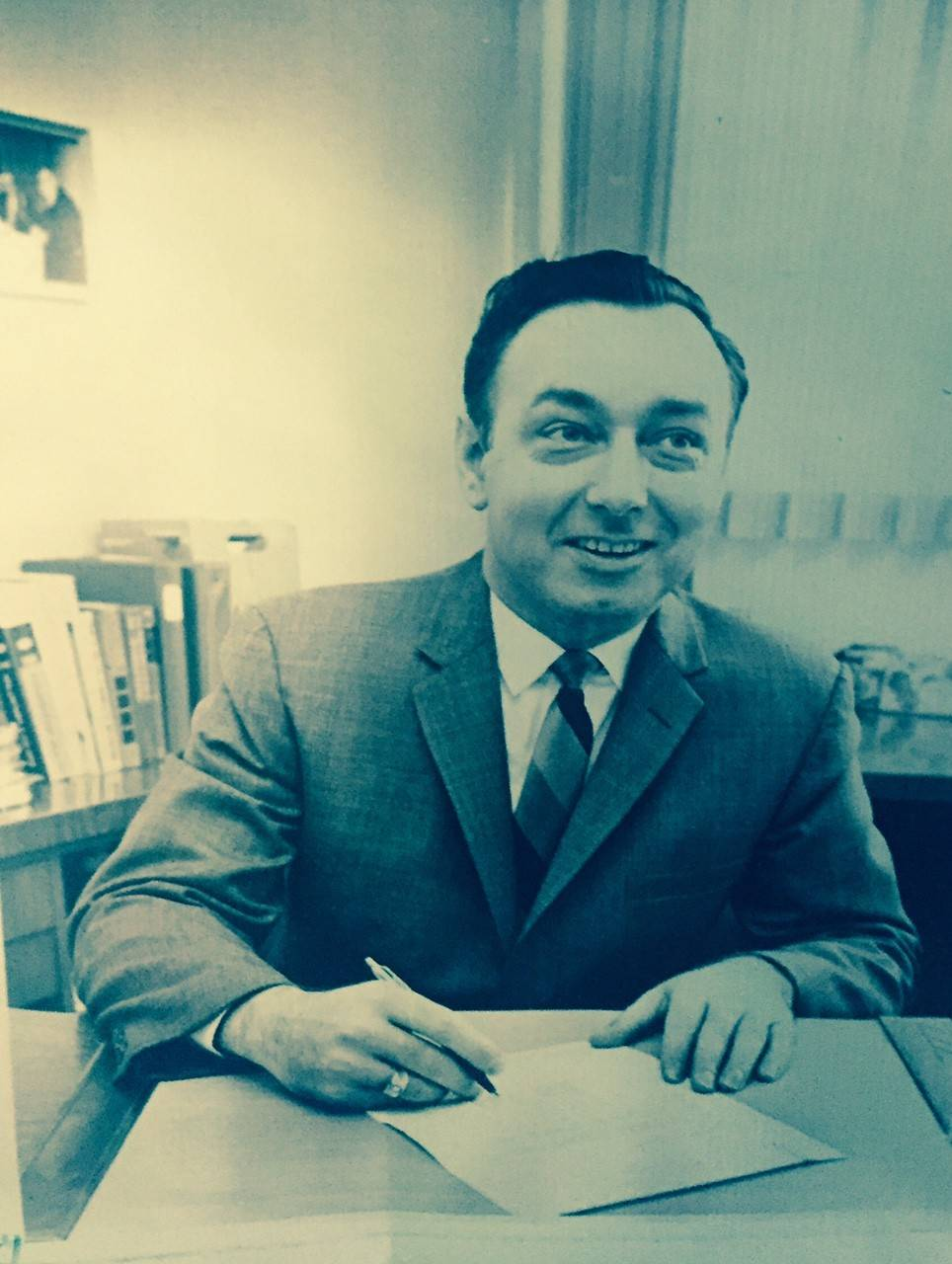 Businessman Donald Amfahr working behind his desk, doing a job he loved.