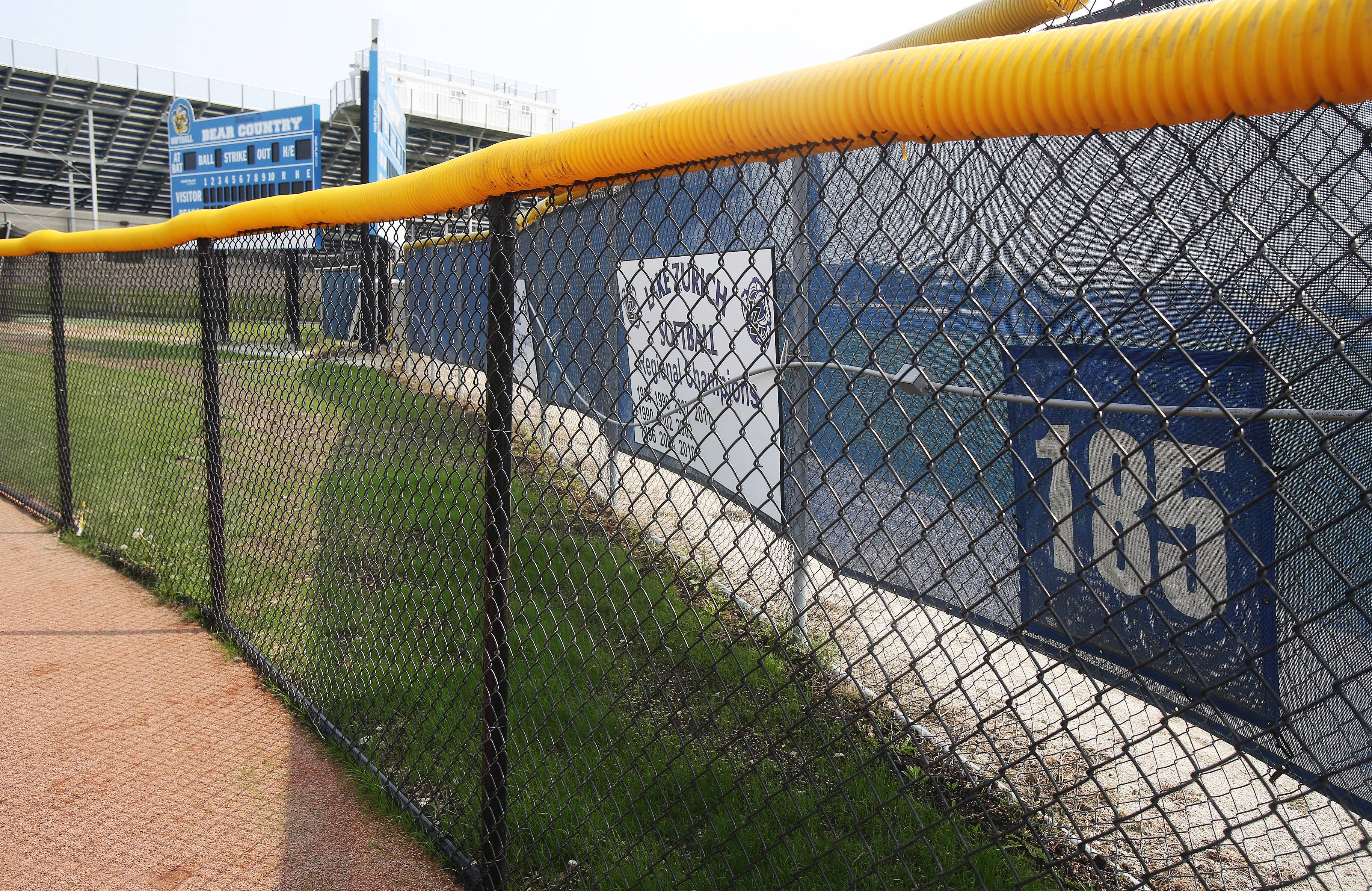 The outfield fence at Lake Zurich High School softball field is 185 feet from home plate, the minimum distance allowed by the Illinois High School Association.