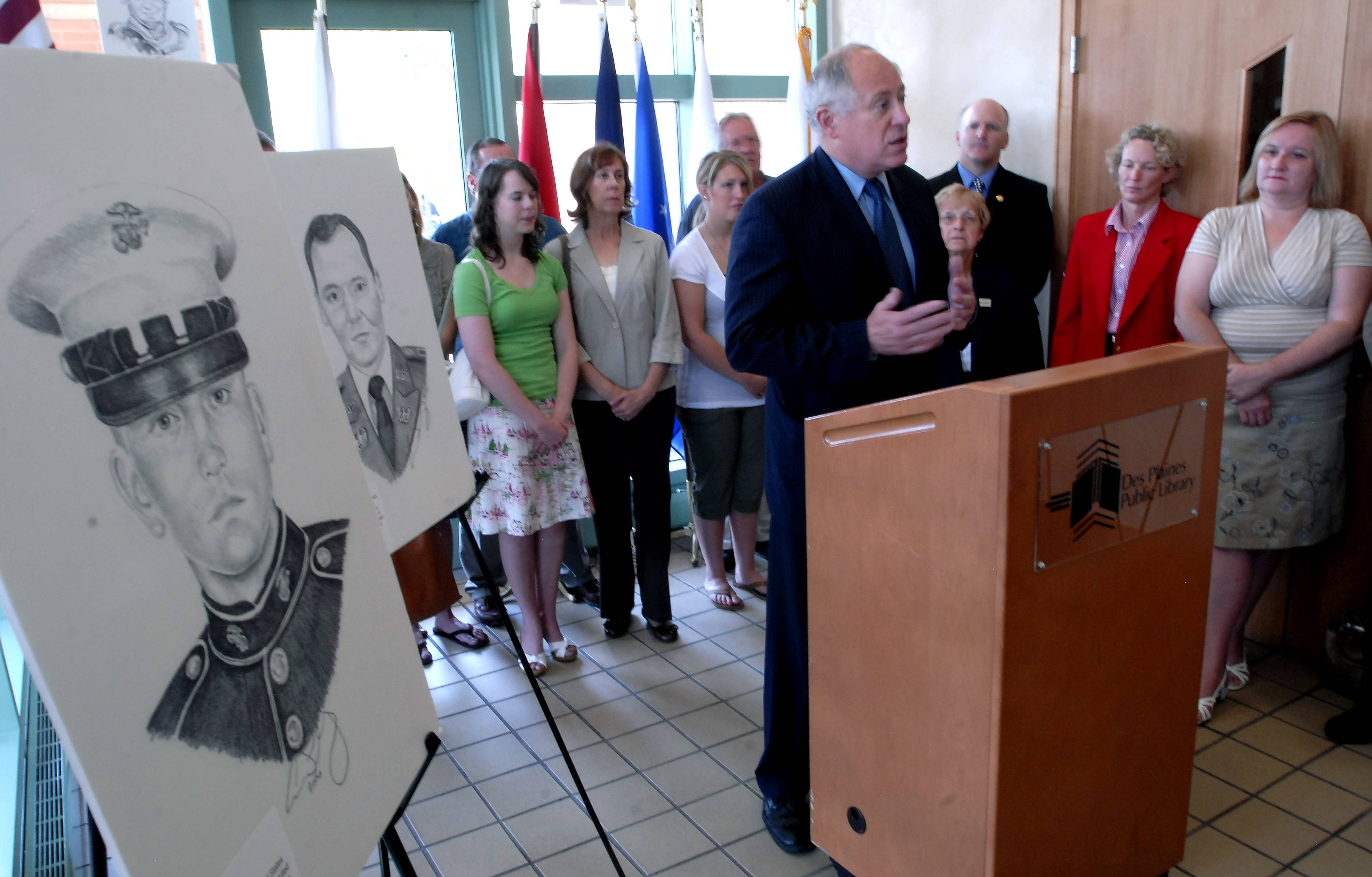 "Surrounded by families of soldiers killed during the war, then-Lt. Gov. Pat Quinn speaks at the unveiling of the ""Portrait of a Soldier"" exhibit at the Des Plaines Public Library in 2008."