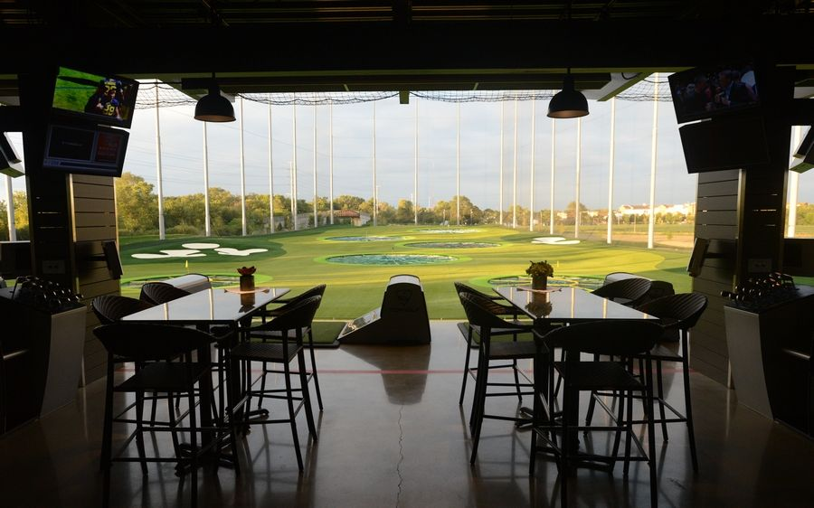 Each of the 102 hitting bays at the new Topgolf Naperville offers a TV, heaters and seating designed to mimic a living room. The new golf entertainment venue opens at 9 a.m. Friday, Sept. 4.