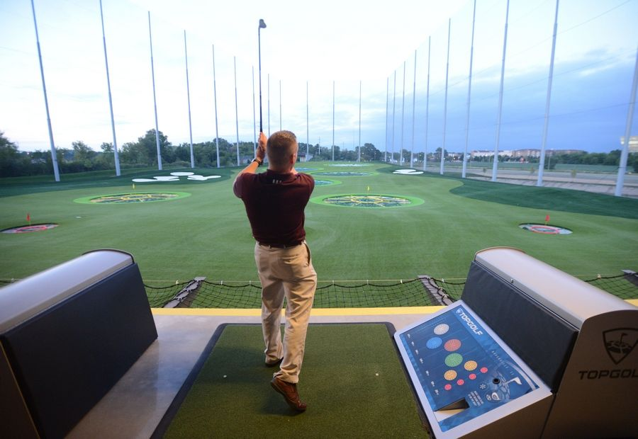 Matt Baylor of the Chicago District Golf Association takes a few swings Wednesday at the new Topgolf in Naperville, the company's second suburban location. The golf entertainment venue opens at 9 a.m. Friday, Sept. 4.