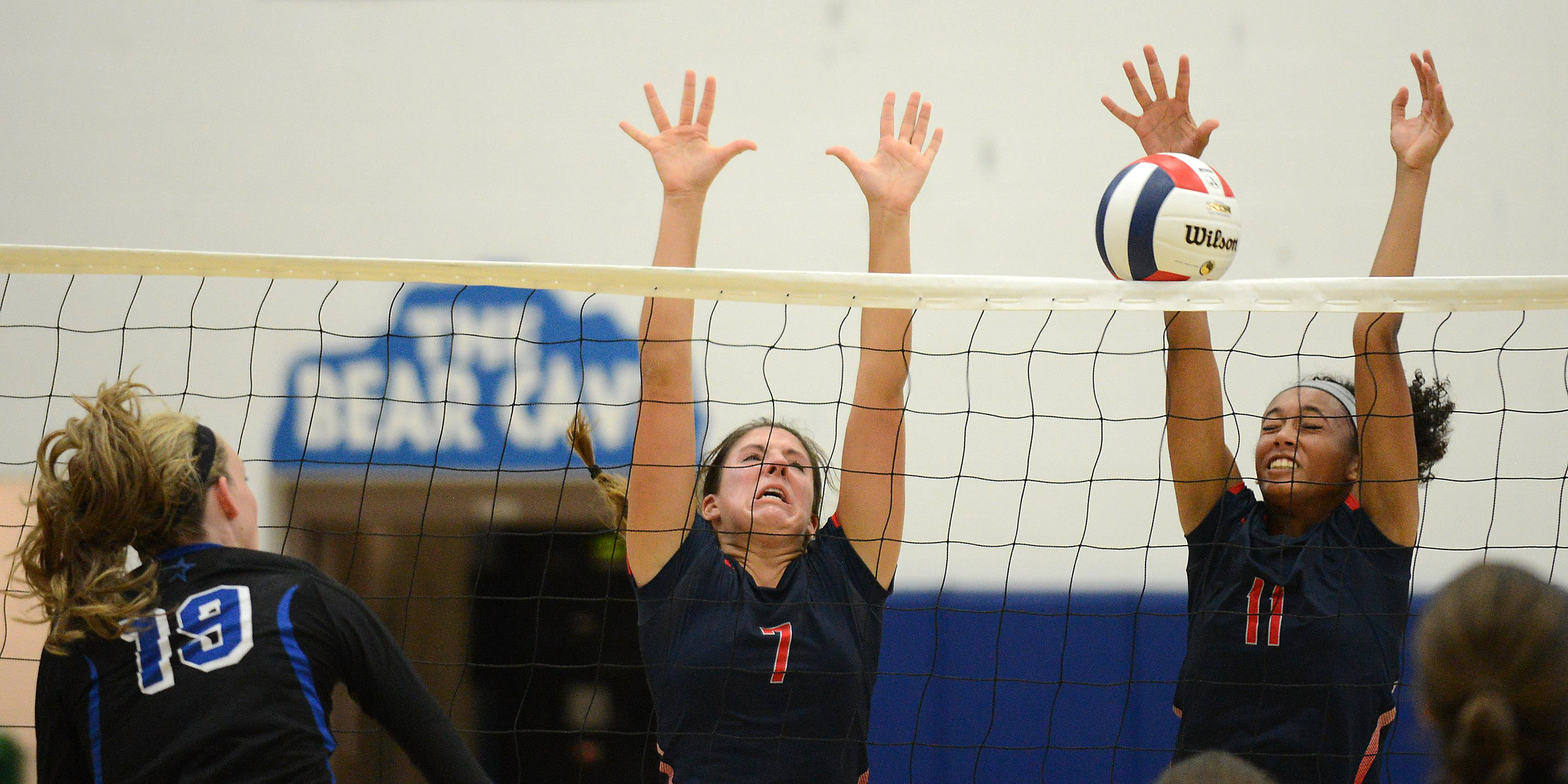 Above: South Elgin's Jasmin Duncan (11) blocks a shot by St. Charles North's Abigail Graham Tuesday in St. Charles. Below: St. Charles North's Samantha Lappin sets for a teammate.
