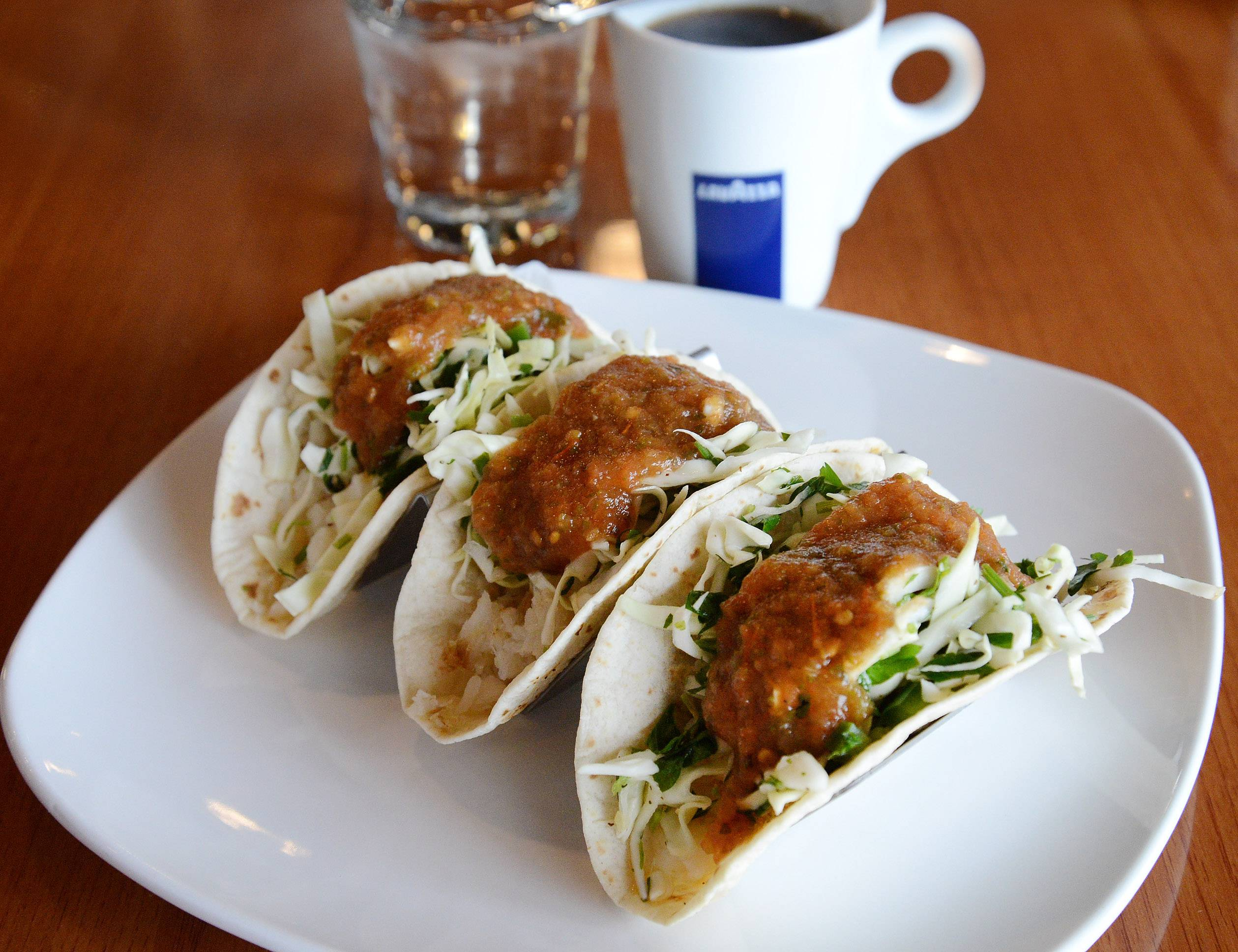 For those who like fish tacos, Maple Cafe adds a twist by marinating the fish in rum before adding the jalapeños and salsa verde to the three flour tortillas.