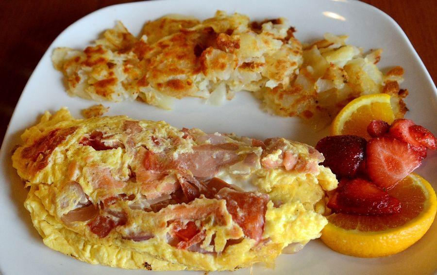 Maple Cafe's Smoked Salmon Omelet combines red onions, tomatoes and cream cheese with the smoked salmon.