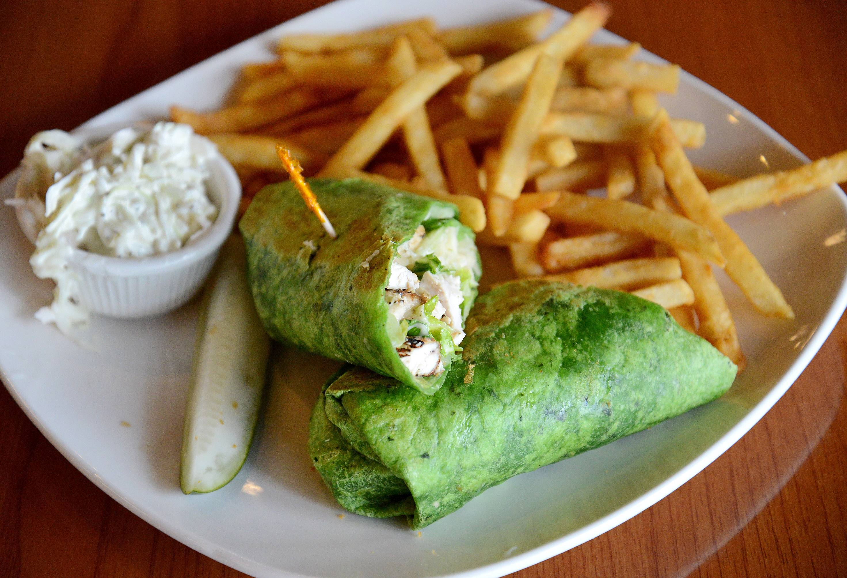Love veggies? Maple Cafe's Baja veggie wrap -- roasted red pepper hummus, cucumber, tomato, olives, greens and grilled zucchini in a spinach tortilla -- might be for you.