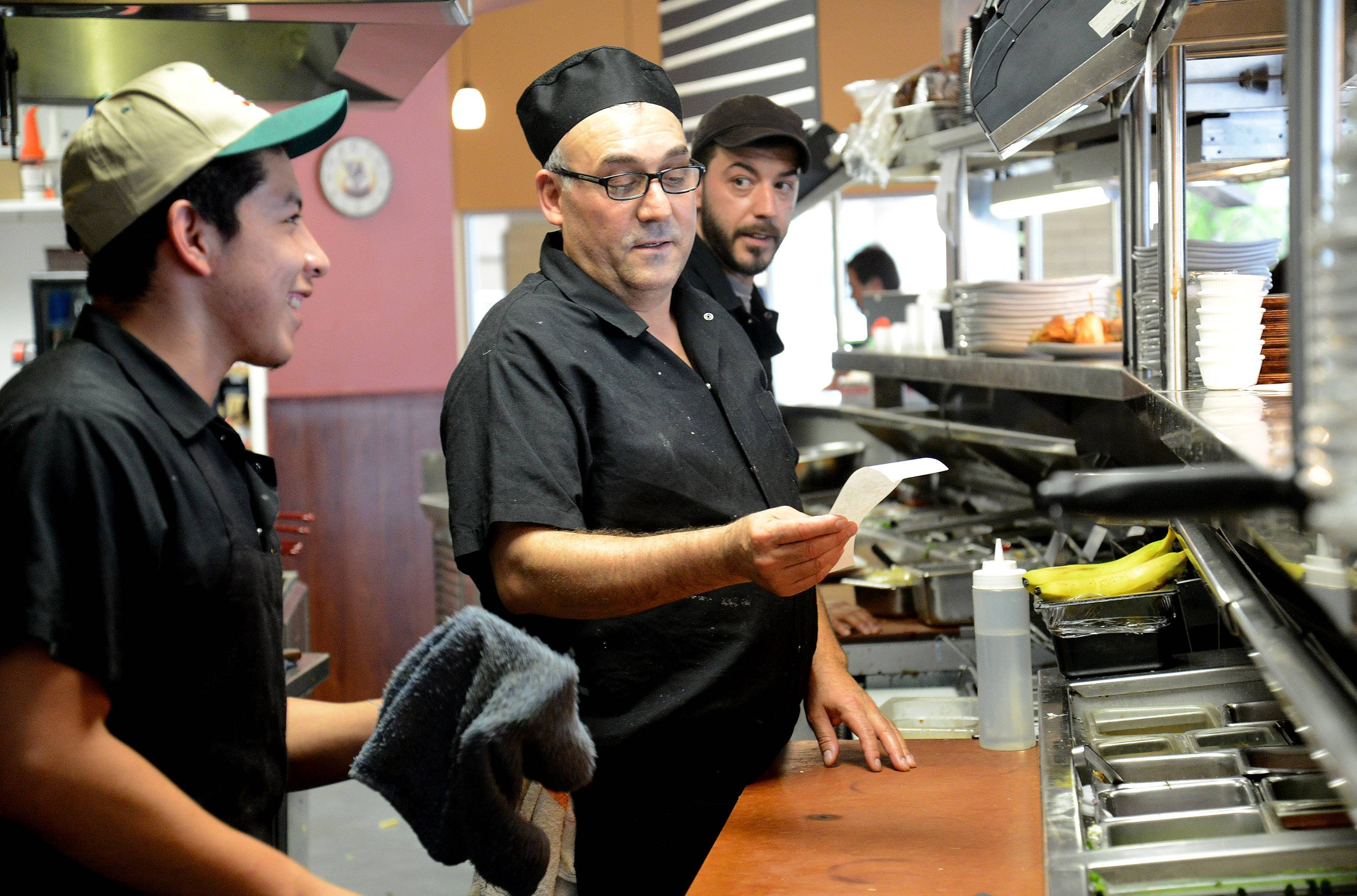 Daniel Morales, left, George Pouras and chef Kostas Anyfantis dish up breakfast and lunch at Maple Cafe in Buffalo Grove.