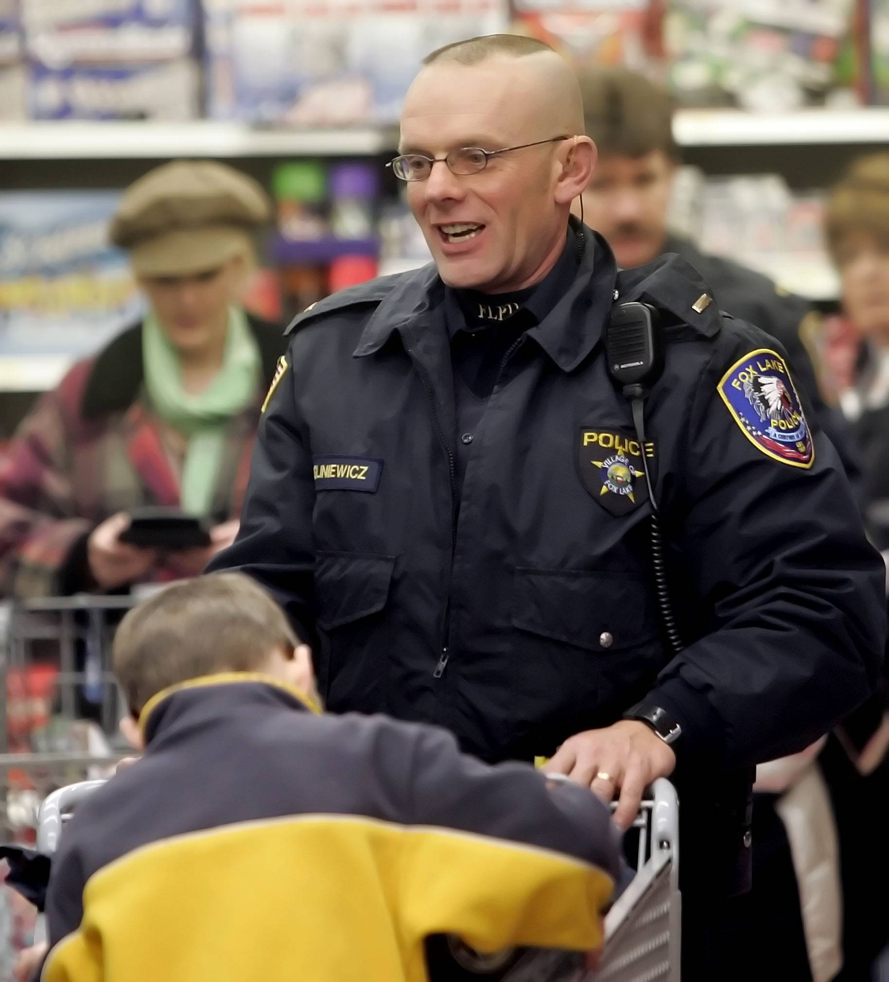 Fox Lake police Lt. Charles Joseph Gliniewicz played his part in helping the community, colleagues said, here participating in Shop with a Cop.