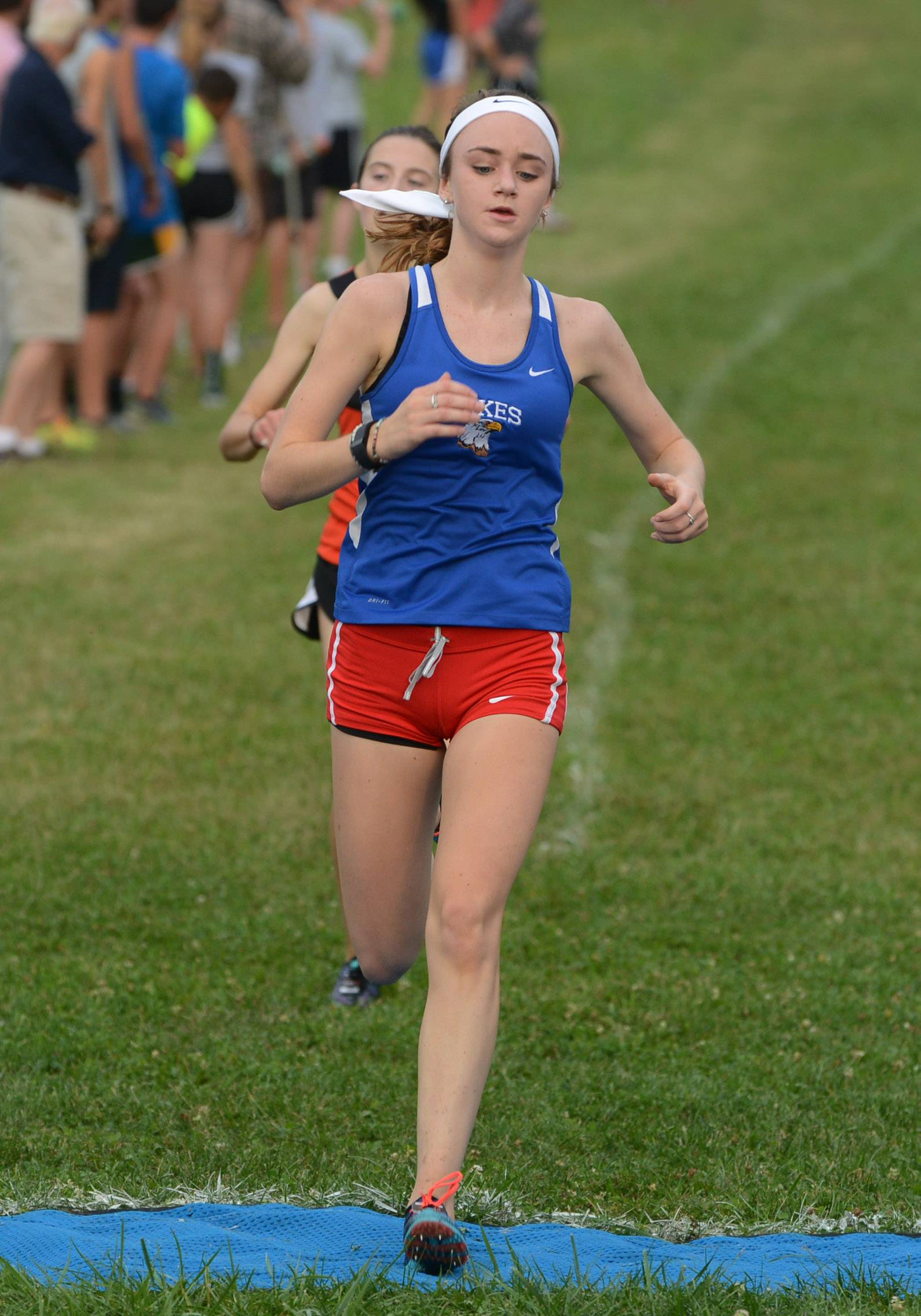 Lakes' Kortney Schardt finishes second in the girls cross country invite at Lakewood Forest Preserve near Wauconda on Wednesday.