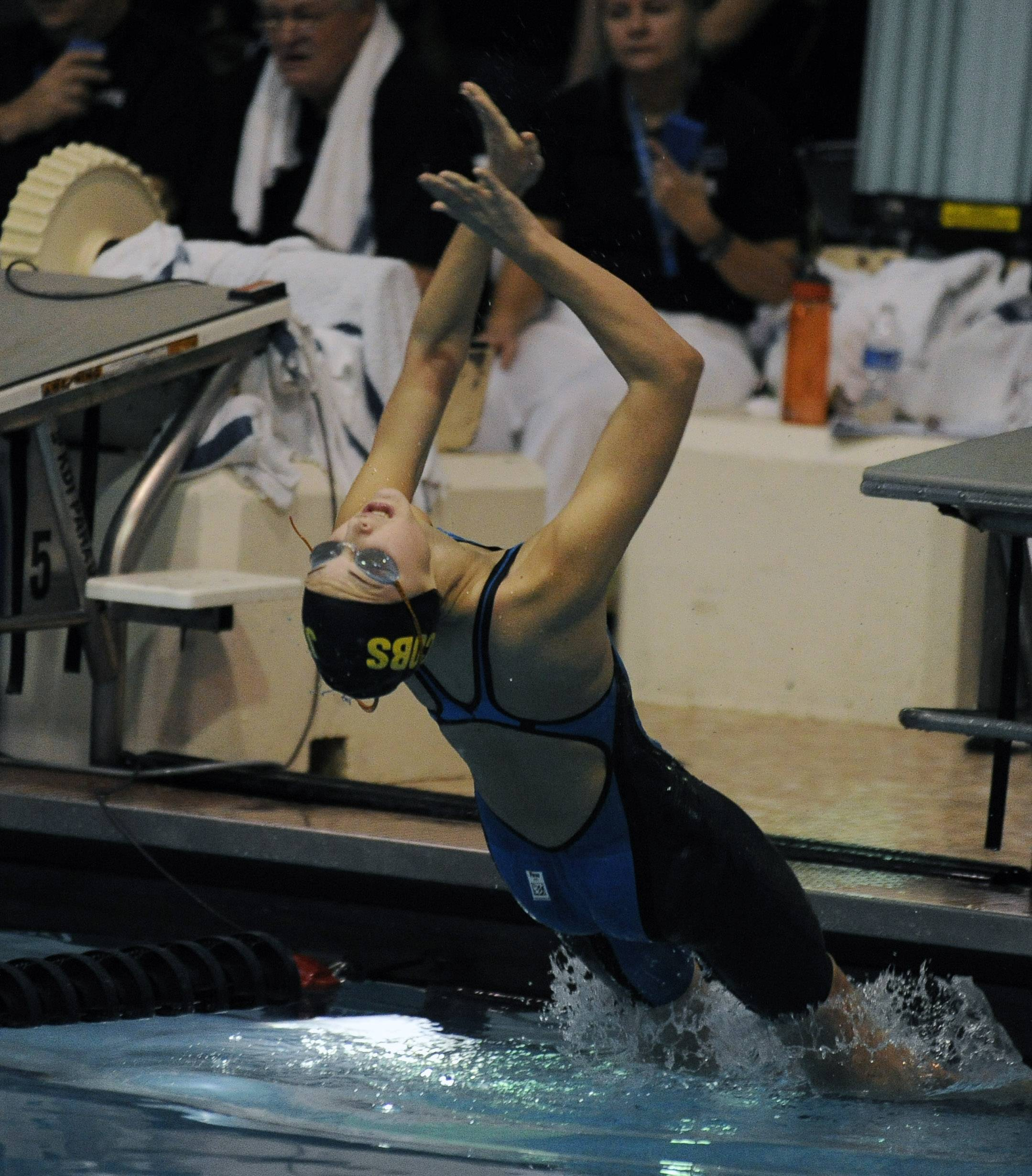 Izzy Bavaro of Jacobs powers off the block for in the 100-yard backstroke at the state prelims in Evanston last season.