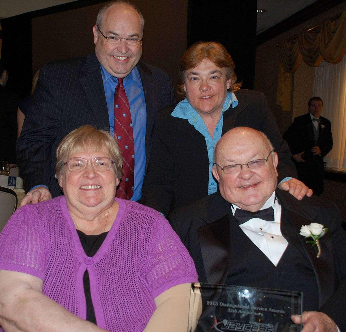 Pat Pradel, bottom left, was married to longtime Naperville Mayor George Pradel for 55 years before she died Saturday at age 75. She's seen here in May 2013 with two of the couple's children, Gary and Carol Pradel.