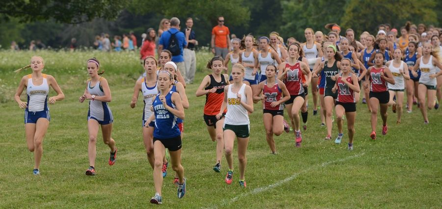 Runners hit the course during the Lake County girls cross country invite at Lakewood Forest Preserve near Wauconda on Wednesday.